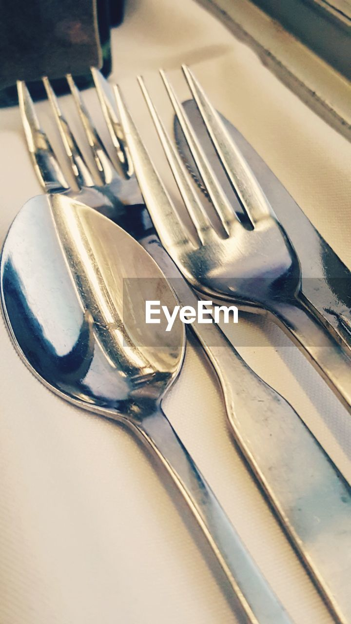 fork, cutlery, still life, table, no people, high angle view, close-up, indoors, plate, food and drink, silver, food, day