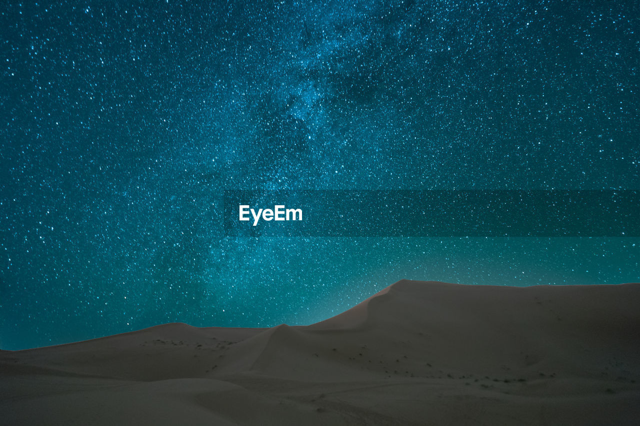 scenics - nature, desert, tranquil scene, beauty in nature, tranquility, arid climate, landscape, sky, nature, land, star - space, night, sand dune, climate, non-urban scene, no people, sand, blue, environment, remote, astronomy, outdoors
