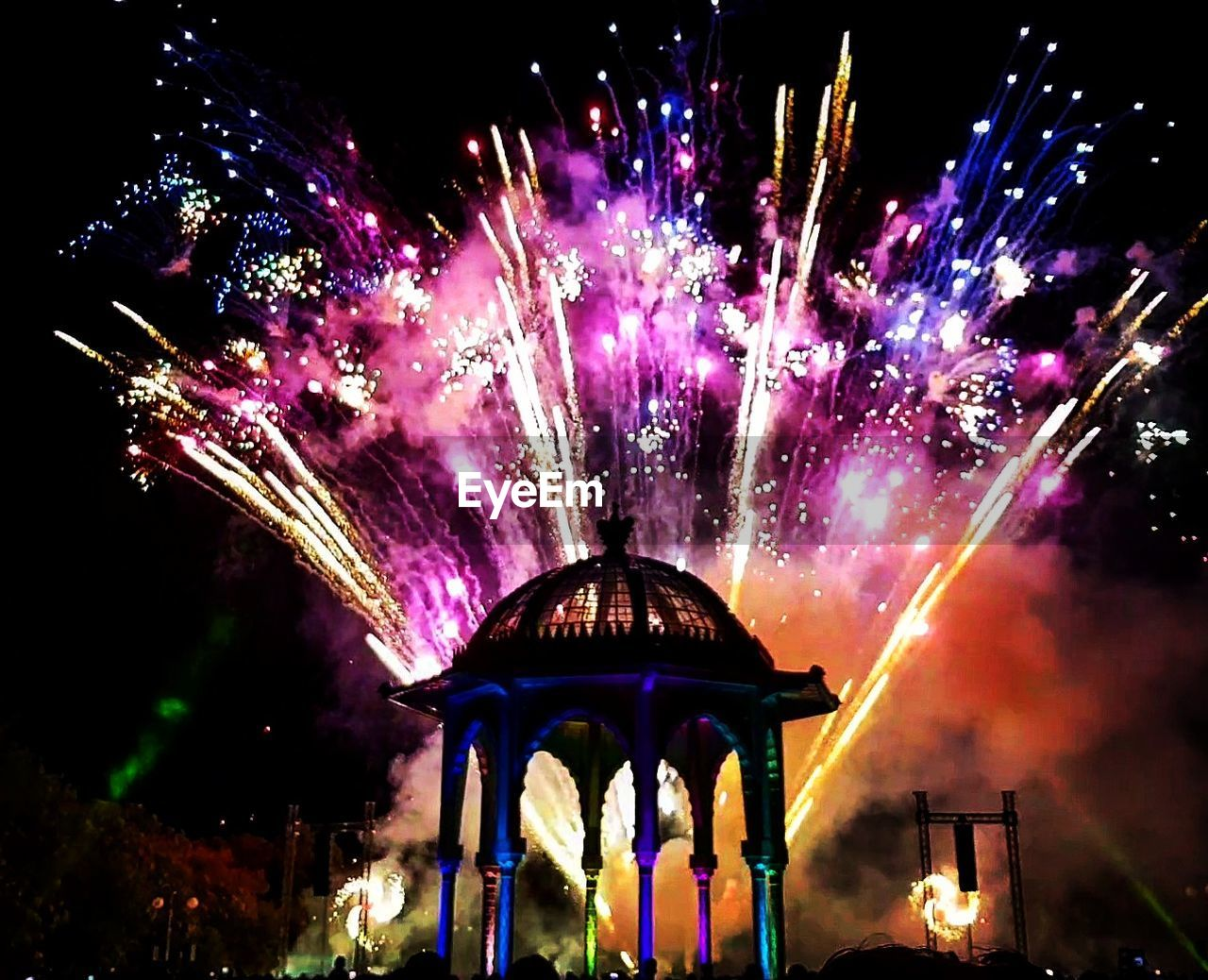 night, low angle view, built structure, illuminated, firework display, architecture, outdoors, celebration, building exterior, no people, sky