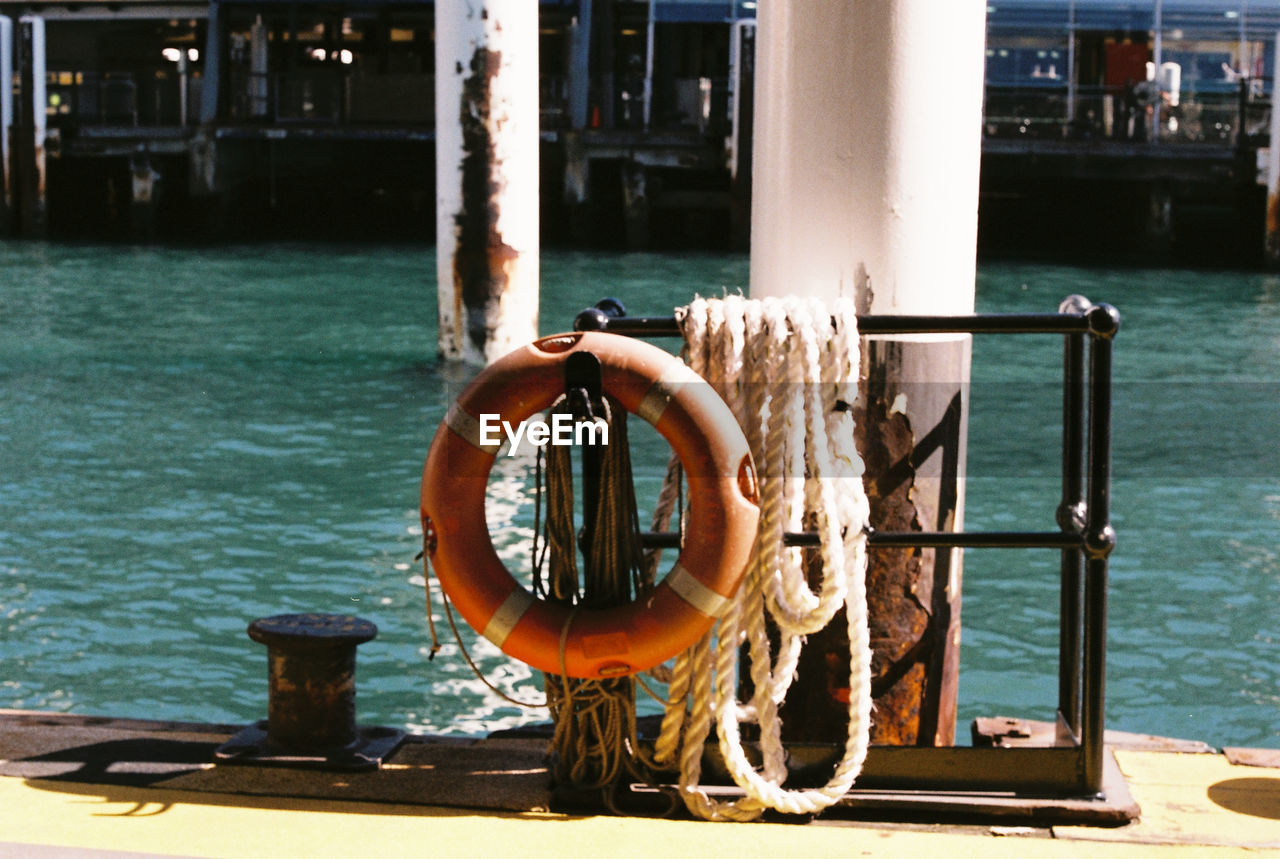 water, day, nature, life belt, sunlight, metal, outdoors, no people, focus on foreground, architecture, railing, sea, pole, safety, transportation, mode of transportation, security, protection, nautical vessel, wheel