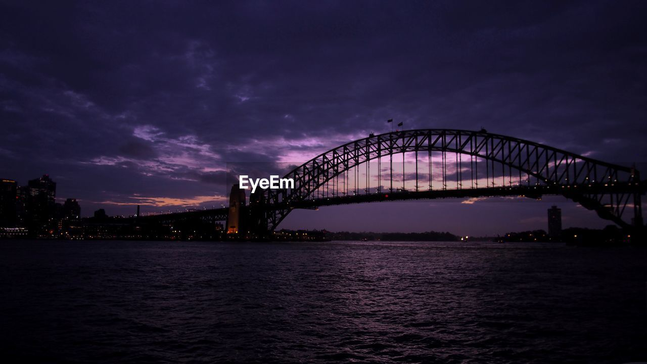 architecture, travel destinations, bridge - man made structure, sky, illuminated, built structure, connection, cloud - sky, water, no people, night, outdoors, scenics, sea, nature, city