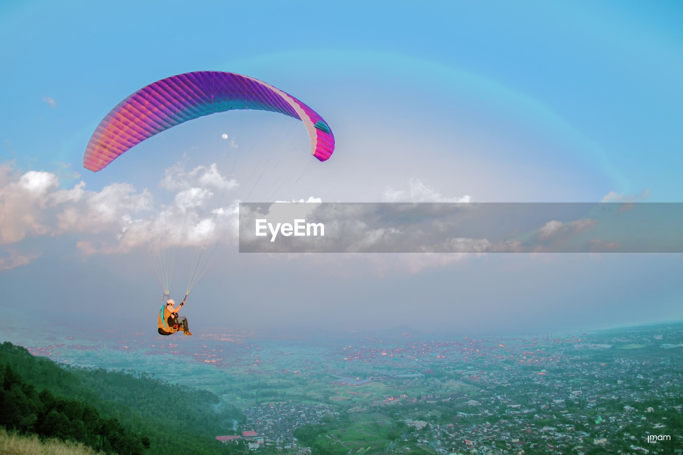 flying, mid-air, parachute, transportation, hot air balloon, sky, extreme sports, adventure, paragliding, sport, air vehicle, mode of transport, leisure activity, travel, multi colored, exhilaration, cloud - sky, scenics, flag, low angle view
