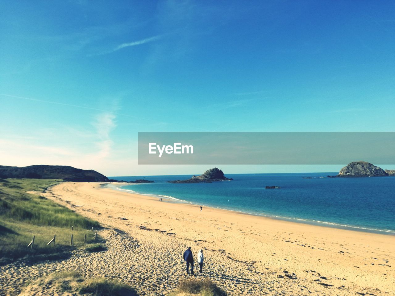 scenics, sea, beach, nature, water, sand, beauty in nature, blue, tranquil scene, tranquility, sky, horizon over water, day, outdoors, two people, real people, men, clear sky, mammal, people