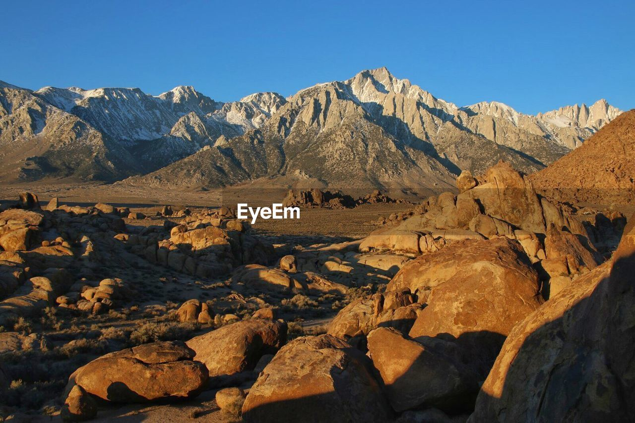 Scenic View Of Snowcapped Mountain Against Clear Sky