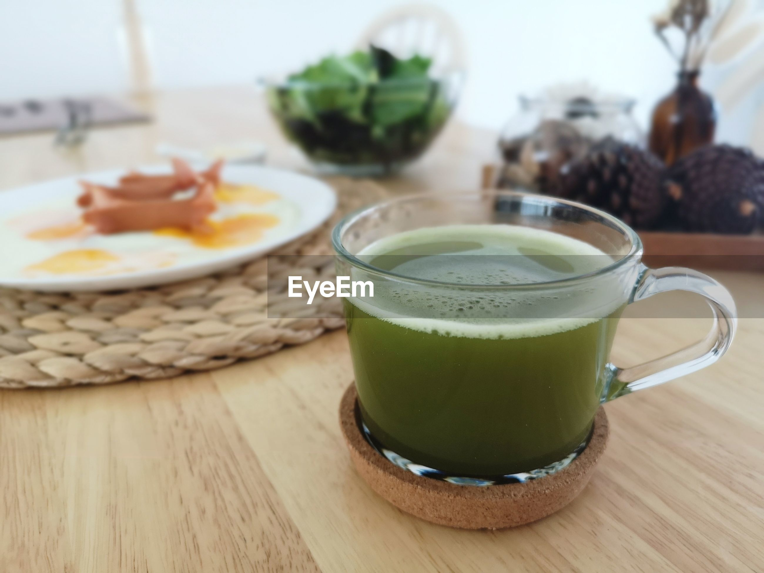 CLOSE-UP OF DRINK WITH JUICE ON TABLE