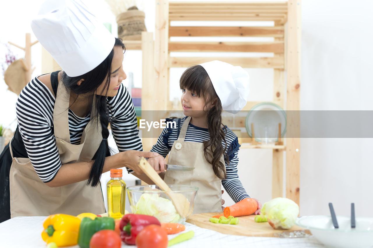 WOMEN HOLDING FOOD AT HOME