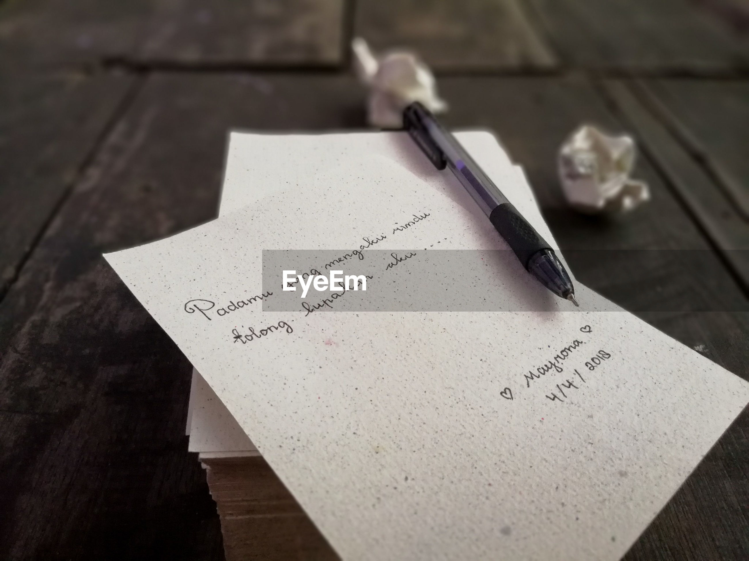 Close-up of text on paper at table