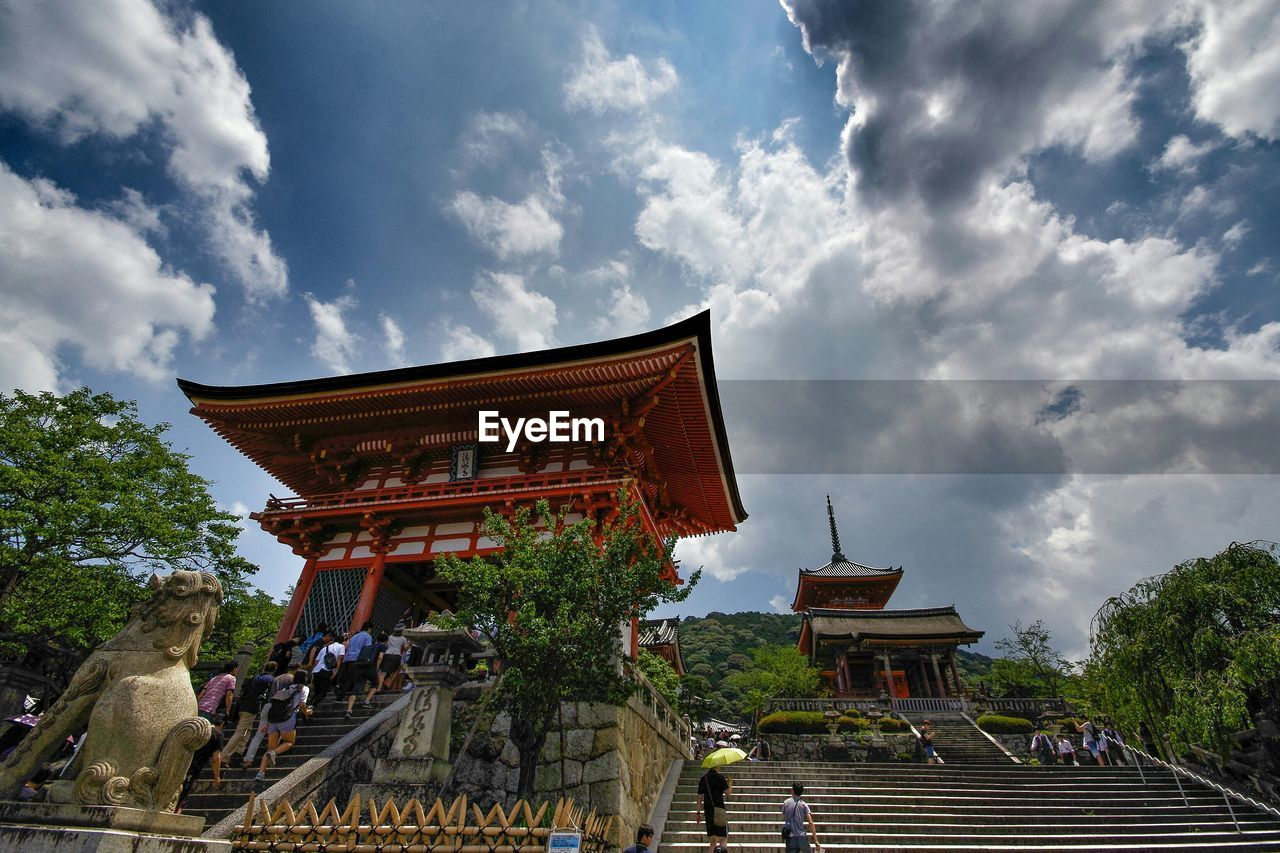 Low angle view of kiyomizu-dera temple against cloudy sky