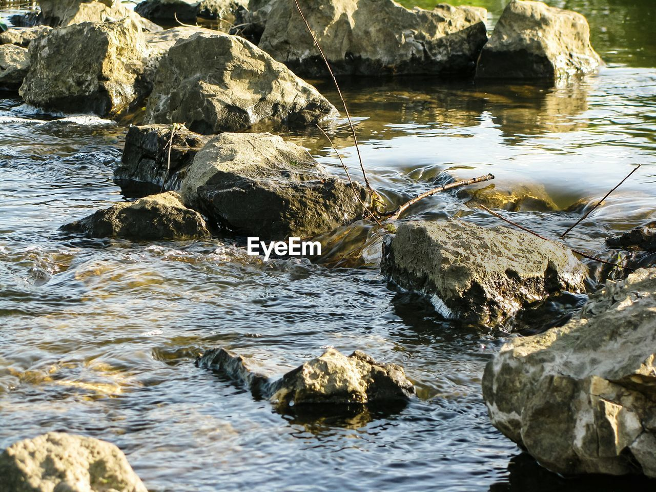 water, rock, rock - object, solid, beauty in nature, nature, motion, day, waterfront, no people, sea, flowing water, outdoors, scenics - nature, tranquility, land, rock formation, flowing, shallow