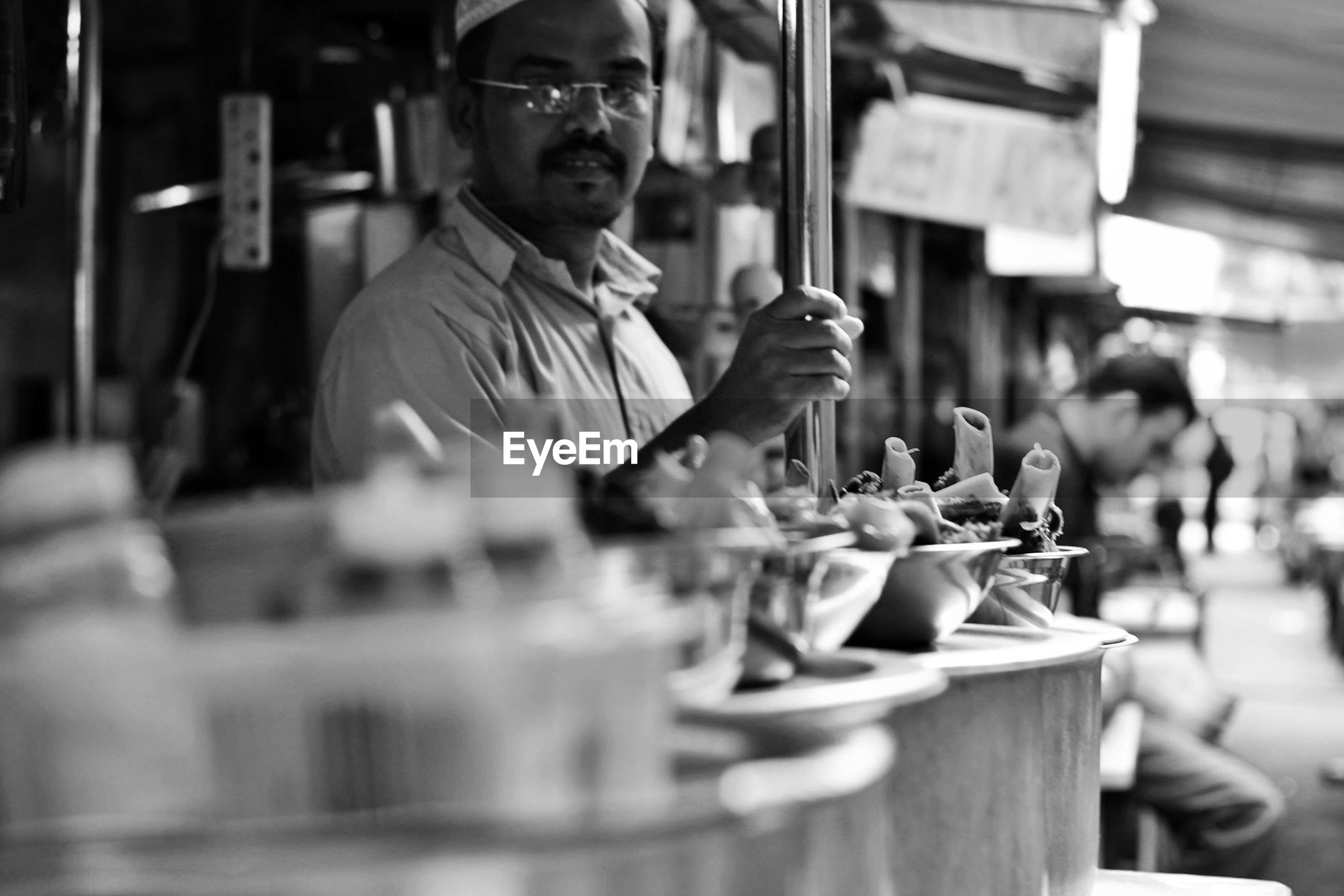 Portrait of male vendor selling street food