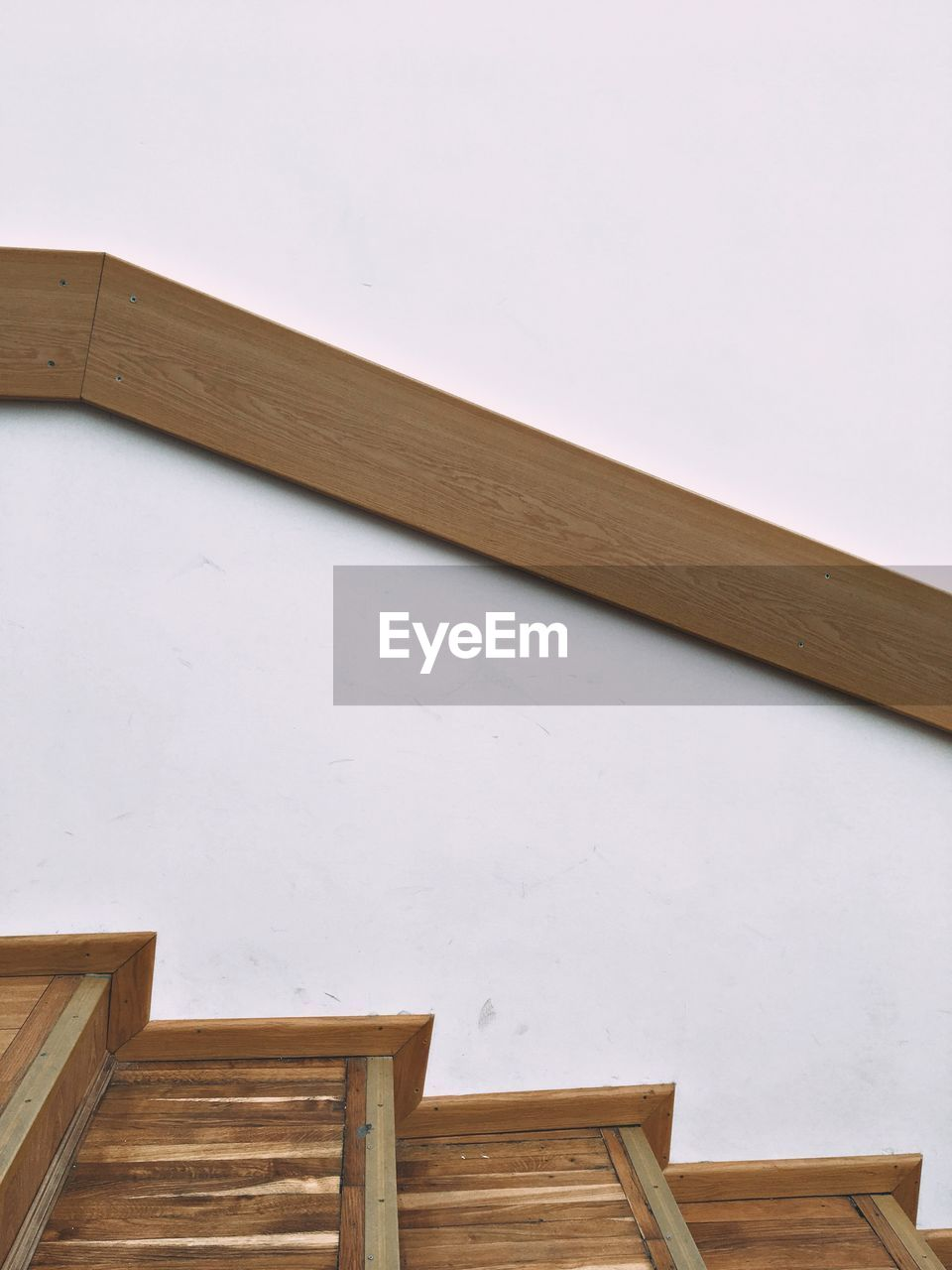 wood - material, architecture, no people, built structure, wall - building feature, indoors, copy space, day, low angle view, home interior, building, seat, wood, wall, railing, brown, white color, absence, ceiling, roof beam