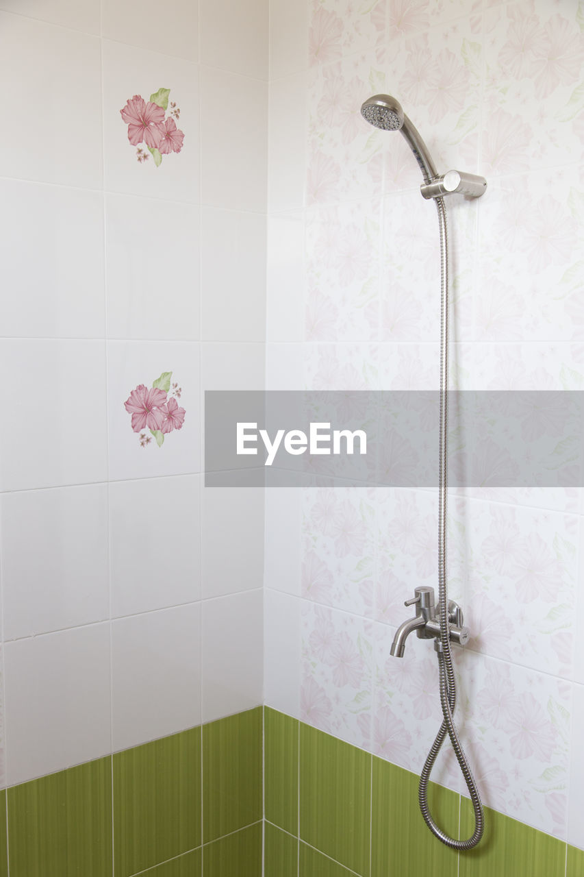 tile, bathroom, domestic bathroom, no people, indoors, domestic room, flower, shower, close-up, shower head, day