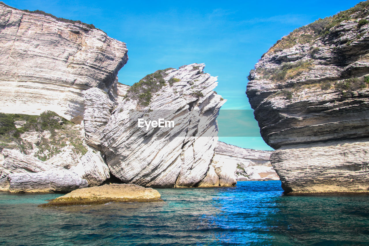 rock, rock - object, water, solid, rock formation, scenics - nature, sea, sky, beauty in nature, nature, waterfront, tranquility, no people, tranquil scene, geology, day, non-urban scene, land, physical geography, outdoors, eroded, formation, stack rock