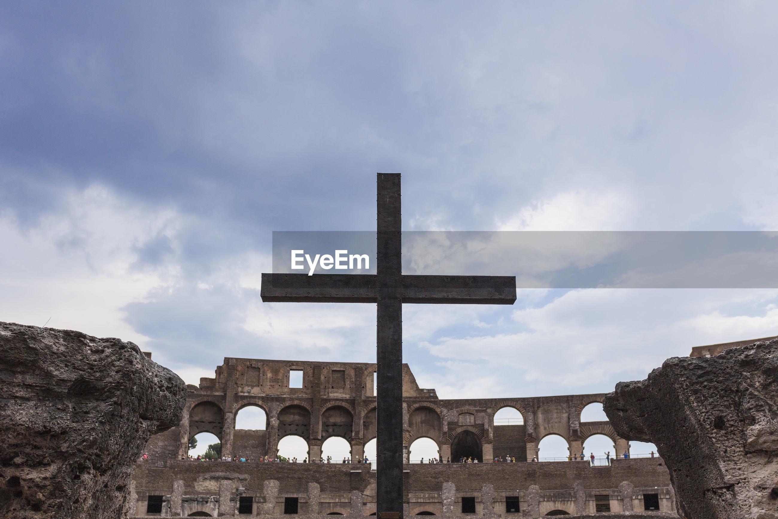 Cross against coliseum