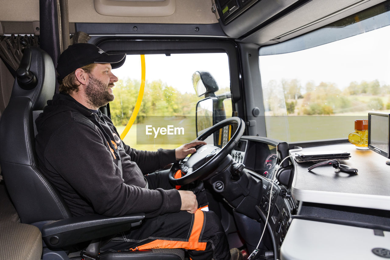 SIDE VIEW OF A MAN IN BUS
