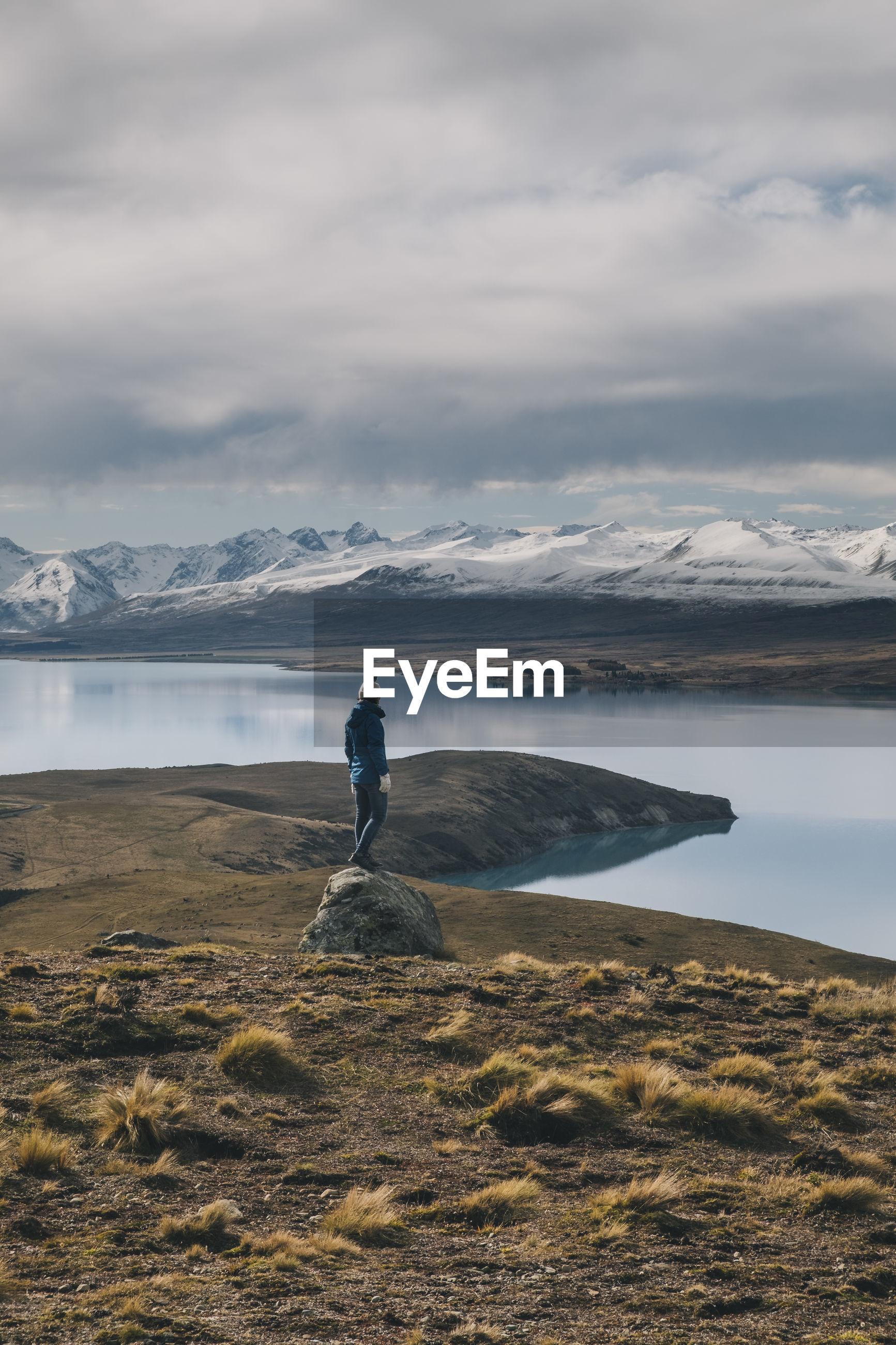 MAN LOOKING AT VIEW OF ROCK