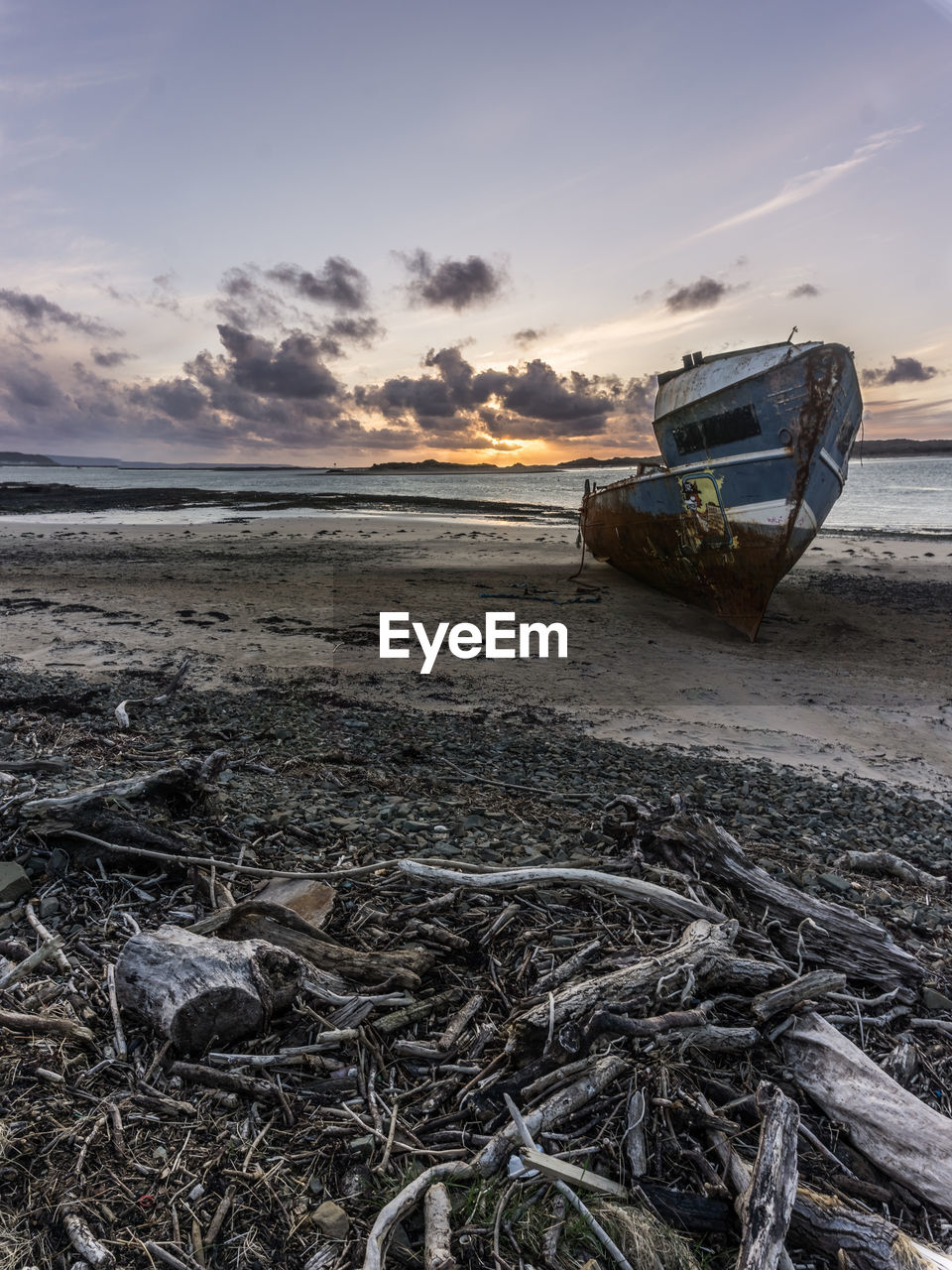 beach, sky, land, sunset, transportation, nautical vessel, water, cloud - sky, sea, mode of transportation, scenics - nature, tranquility, beauty in nature, tranquil scene, nature, no people, abandoned, moored, non-urban scene, horizon over water, outdoors, deterioration, fishing boat, low tide, fishing industry