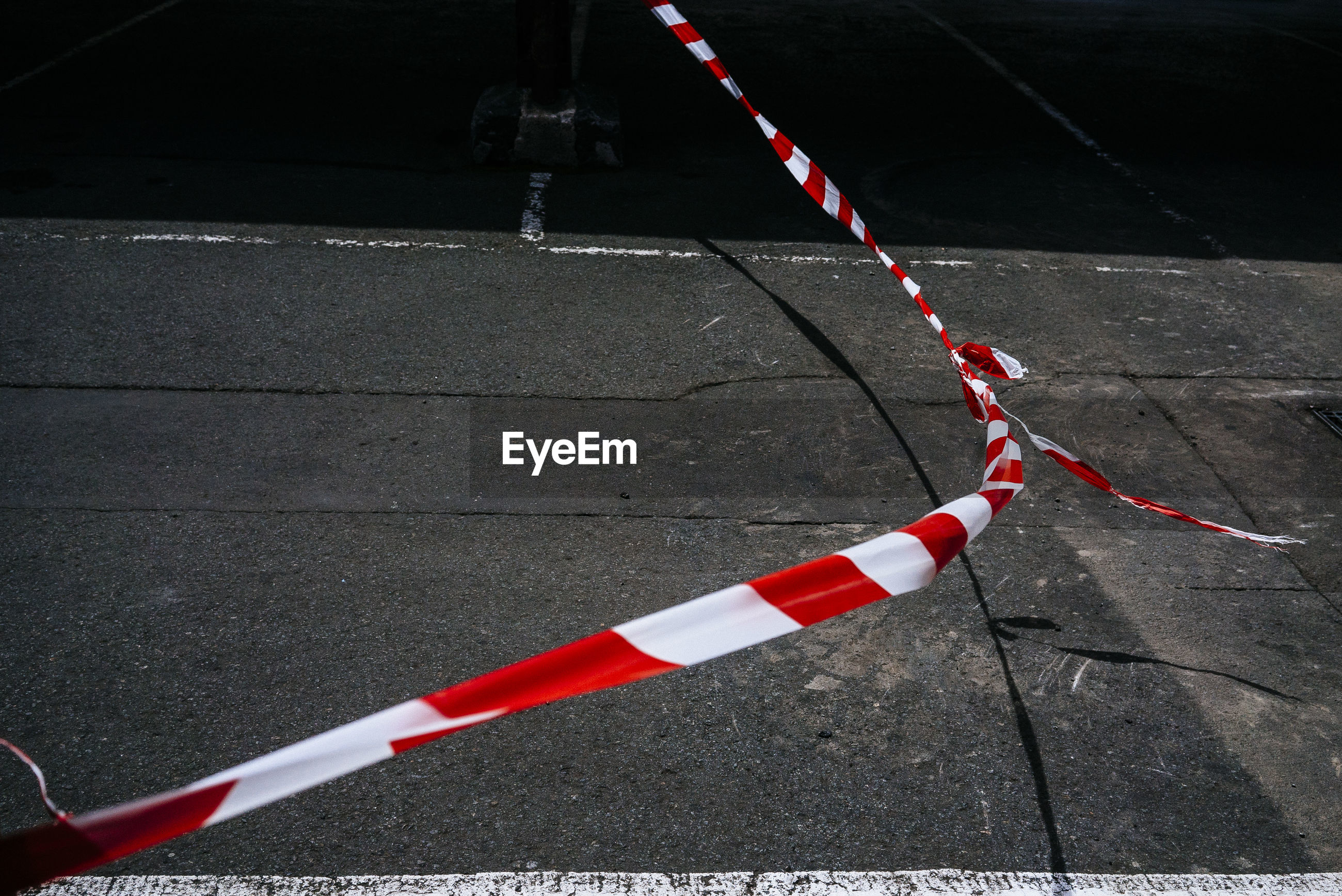 High angle view of cordon tape hanging over road