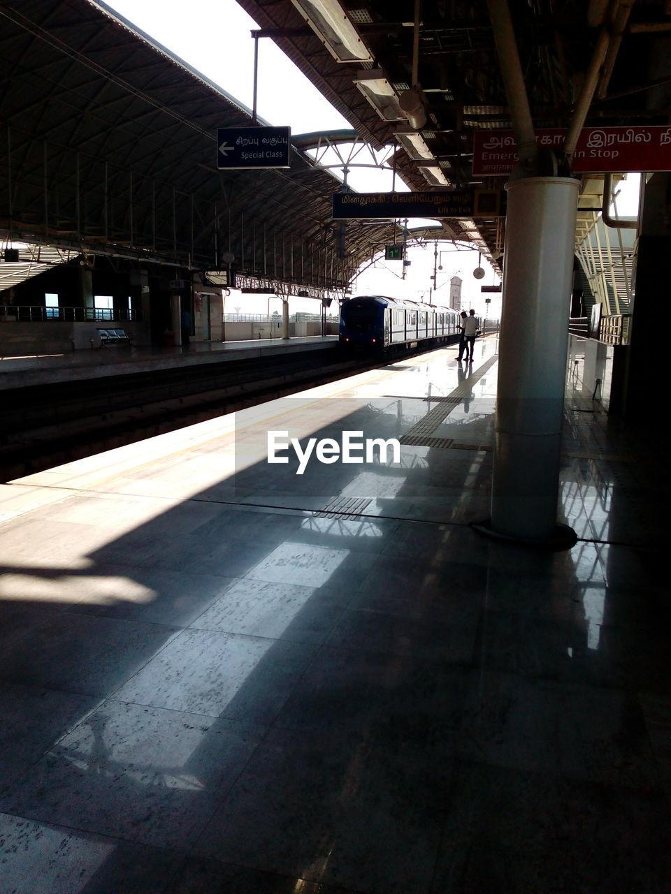 transportation, railroad station platform, architectural column, architecture, built structure, indoors, day, no people