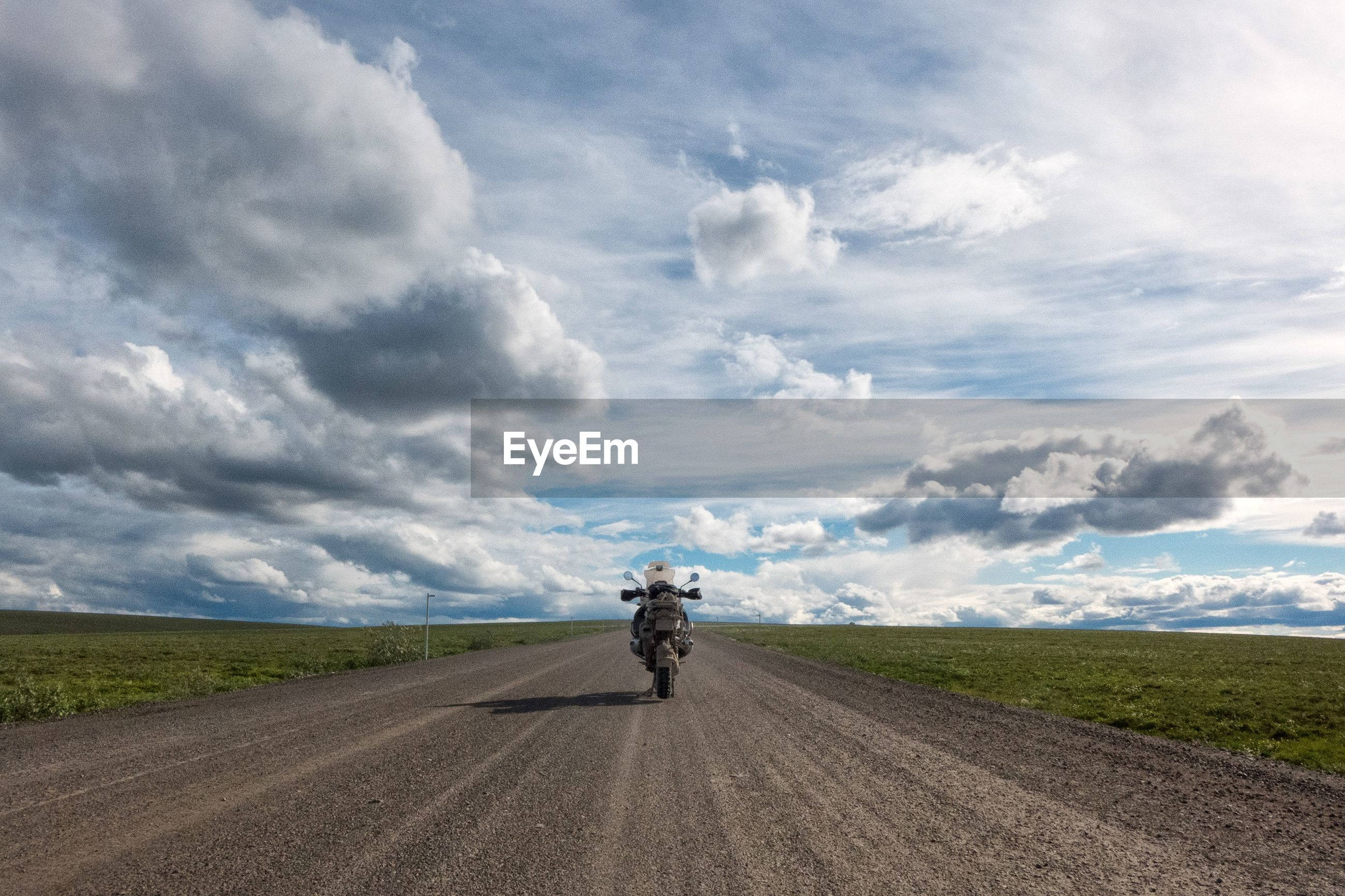 transportation, sky, full length, road, cloud - sky, land vehicle, the way forward, landscape, rear view, cloudy, riding, mode of transport, bicycle, field, lifestyles, country road, cloud, men