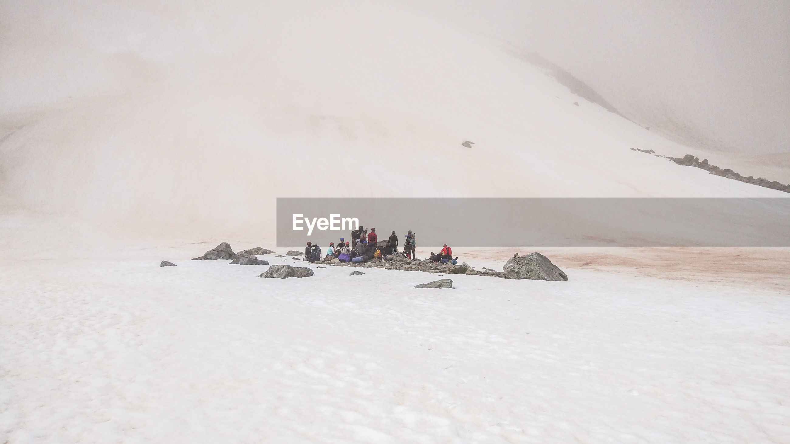 High angle view of people on sand at desert during sunny day