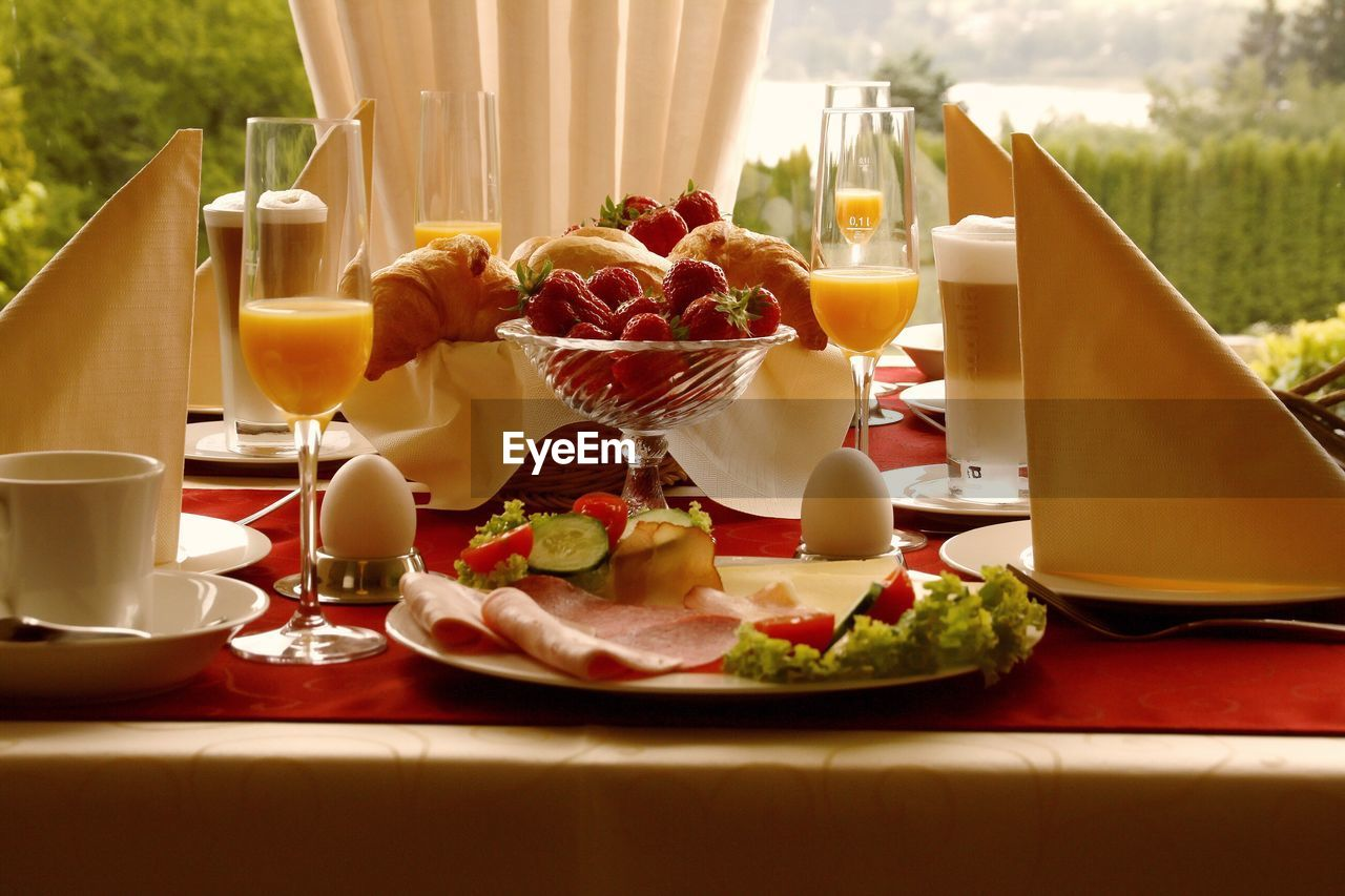 Close-up of fresh healthy breakfast served on table with juice