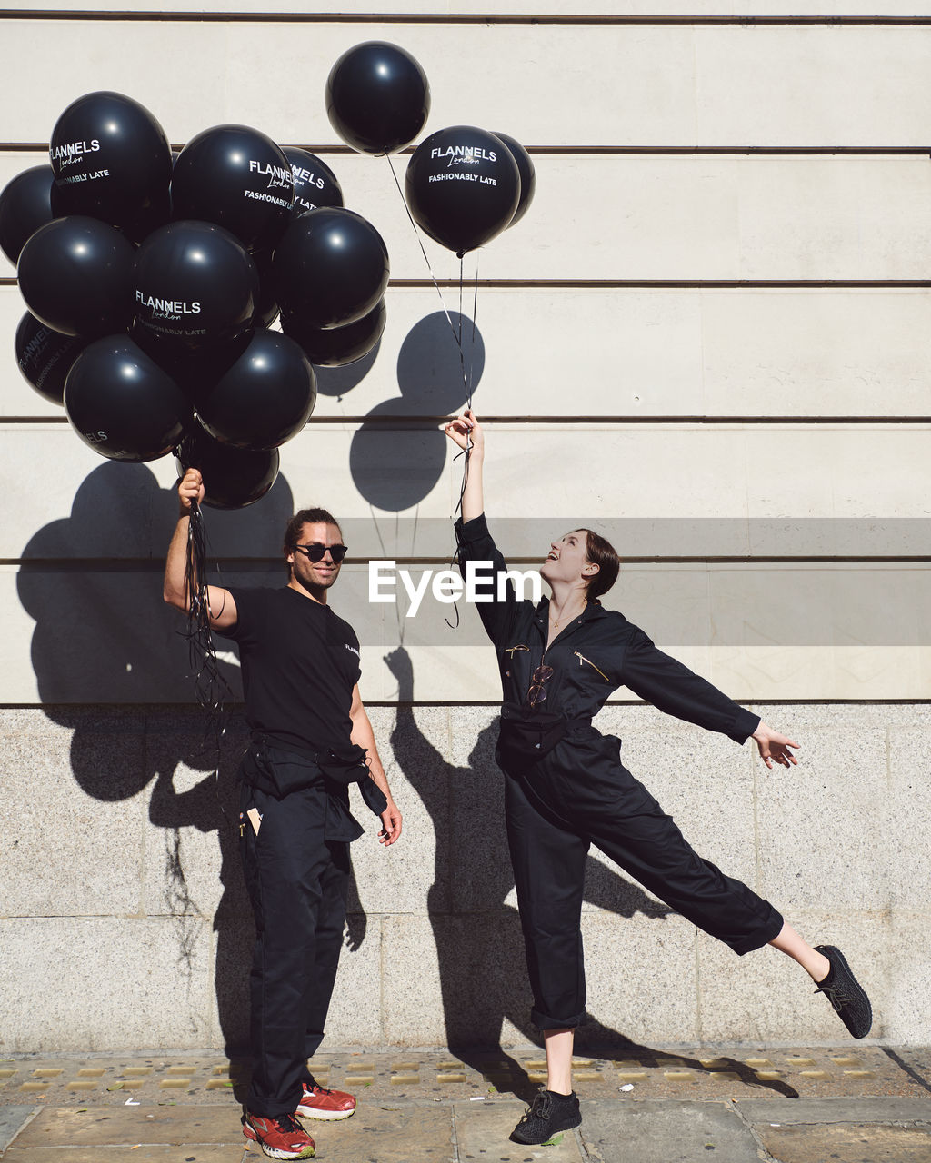 full length, real people, people, balloon, black color, lifestyles, women, men, young adult, togetherness, adult, young men, bonding, front view, suit, males, two people, young women, leisure activity, outdoors, couple - relationship