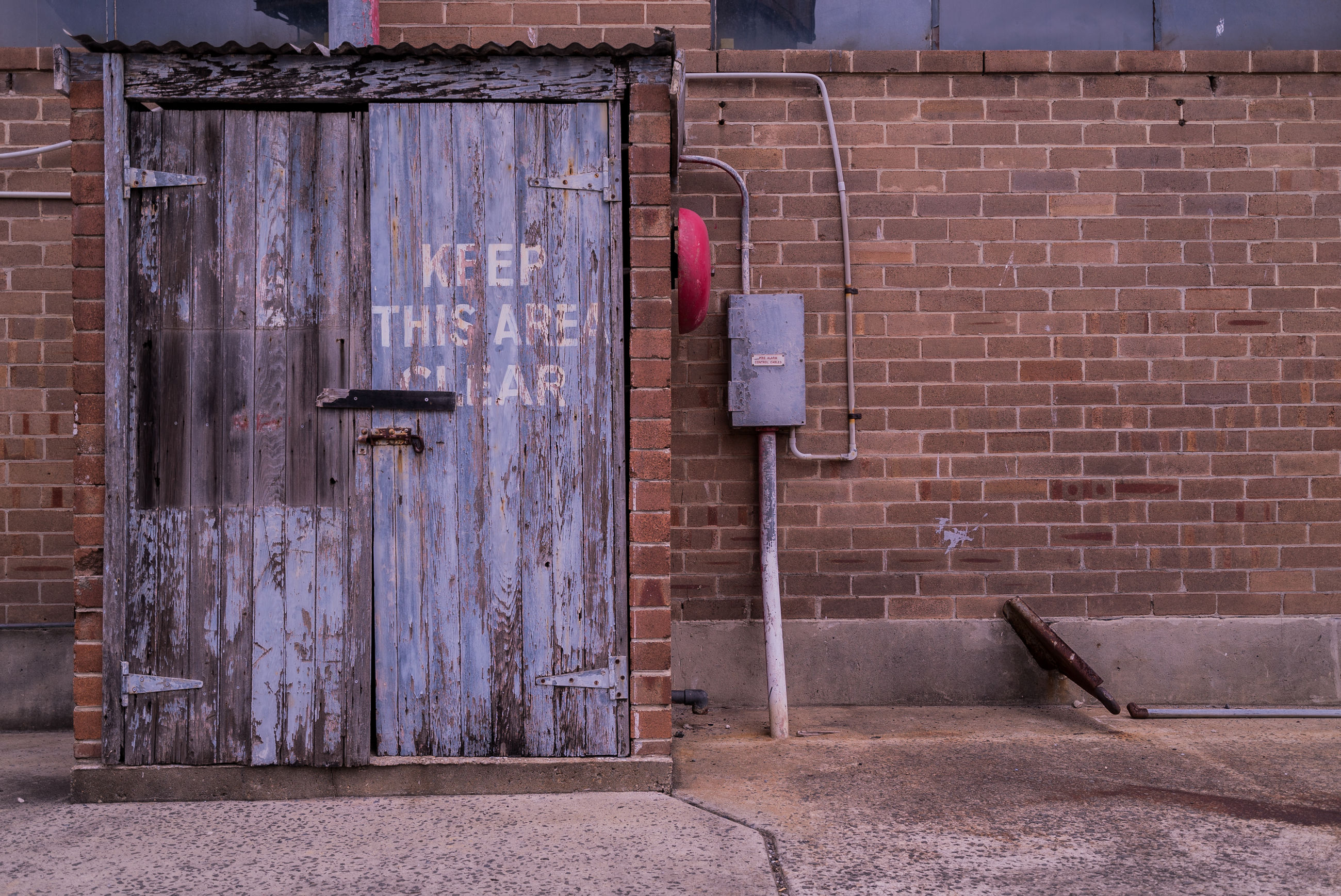 Closed entrance against brick wall