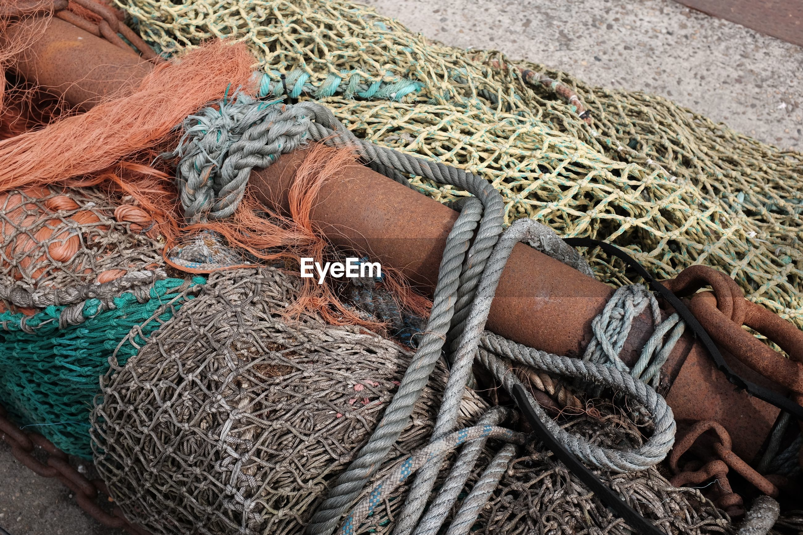 High angle view of fishing nets with pole and ropes