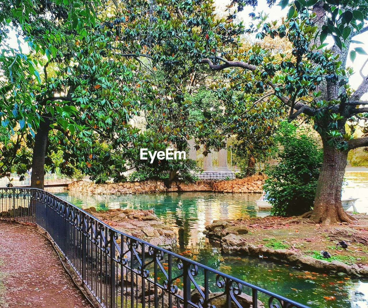 tree, plant, growth, nature, water, architecture, built structure, day, no people, railing, green color, outdoors, branch, river, park, connection, bridge, beauty in nature