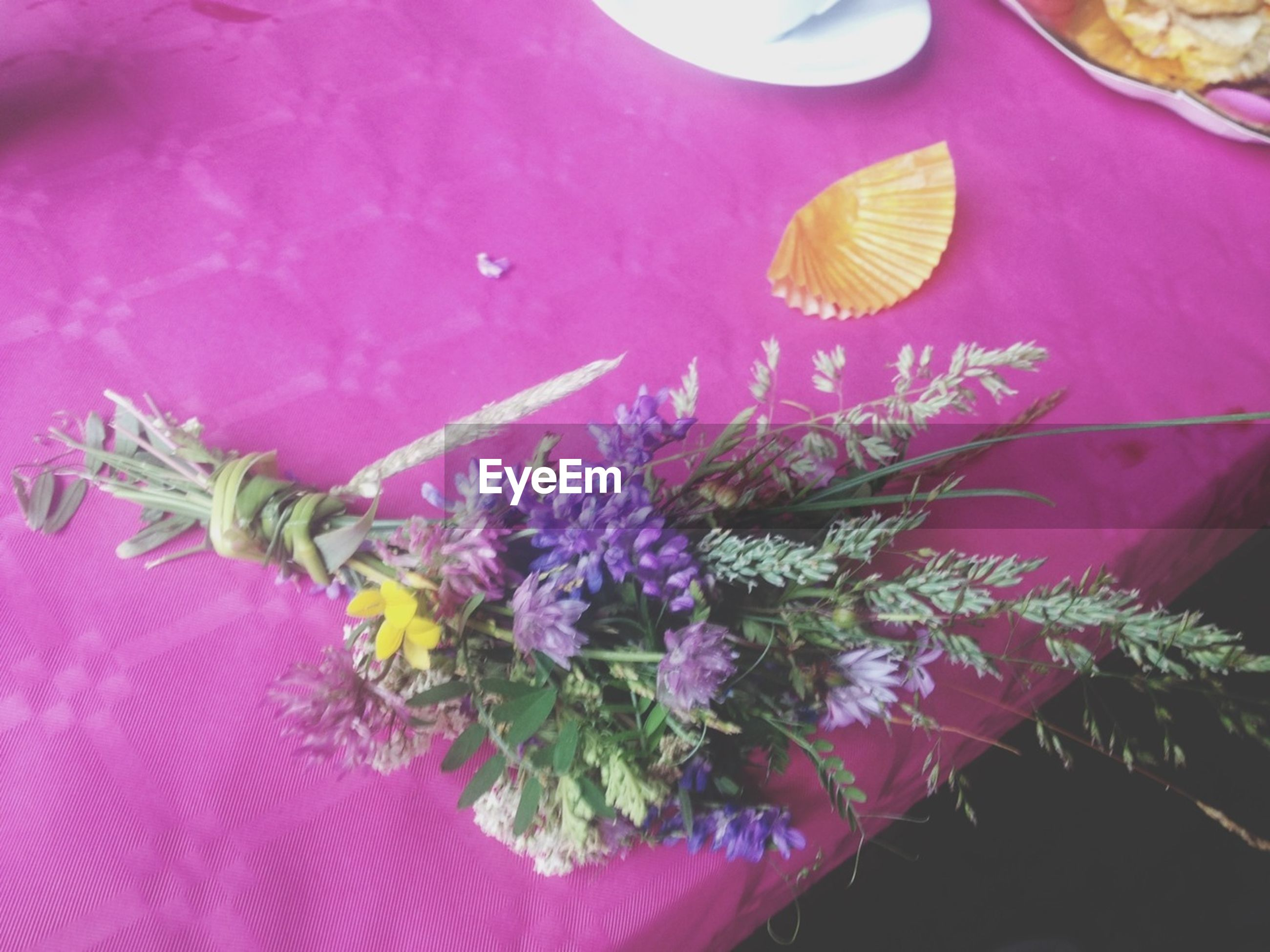 flower, indoors, petal, freshness, close-up, multi colored, fragility, variation, pink color, decoration, high angle view, flower head, purple, still life, no people, table, floral pattern, nature, beauty in nature, pollen