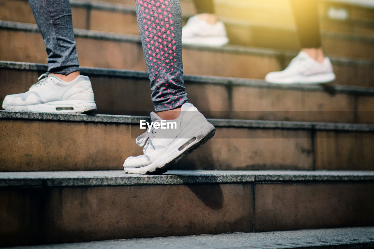 low section, human body part, human leg, body part, real people, lifestyles, one person, shoe, staircase, leisure activity, sport, standing, skill, day, motion, architecture, balance, selective focus, outdoors, human foot, human limb, sock, jeans