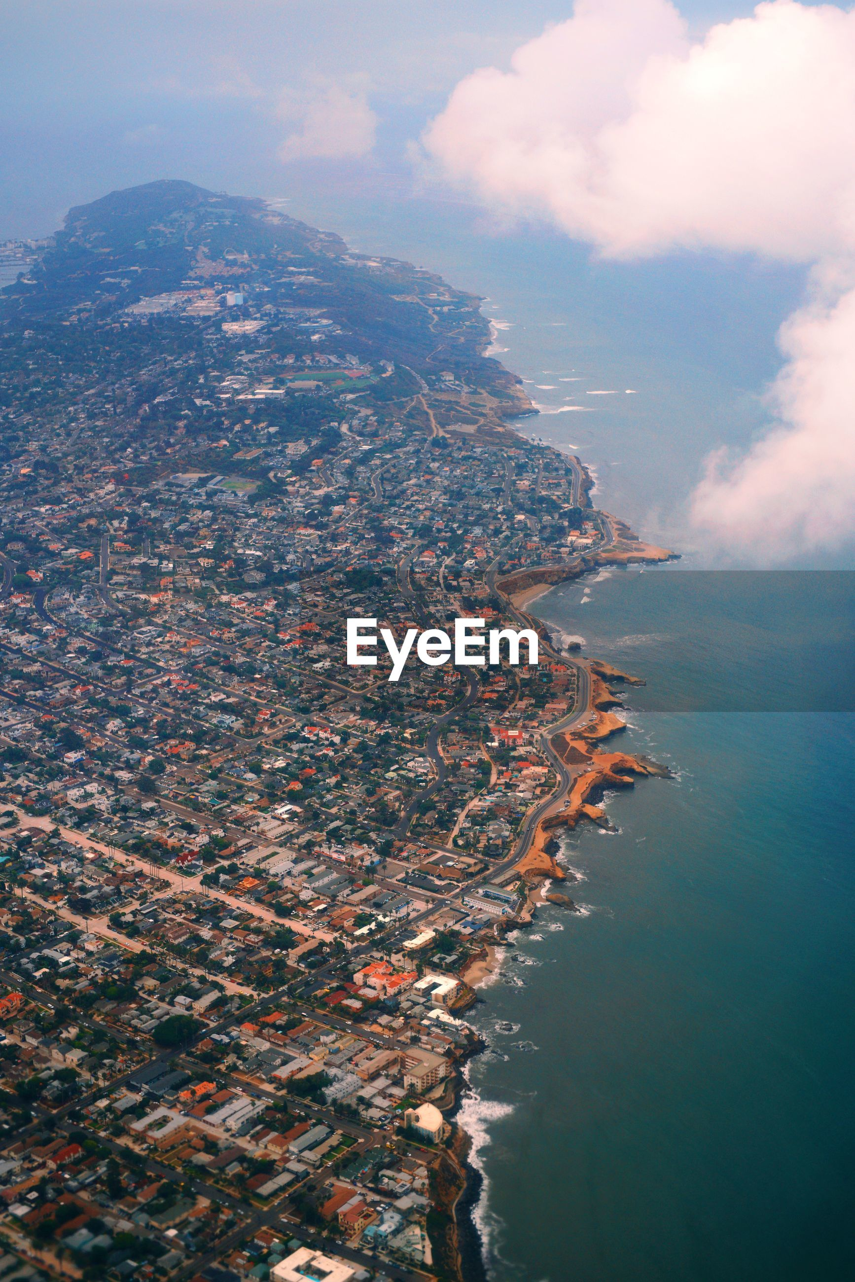 Aerial view of sea by buildings in city