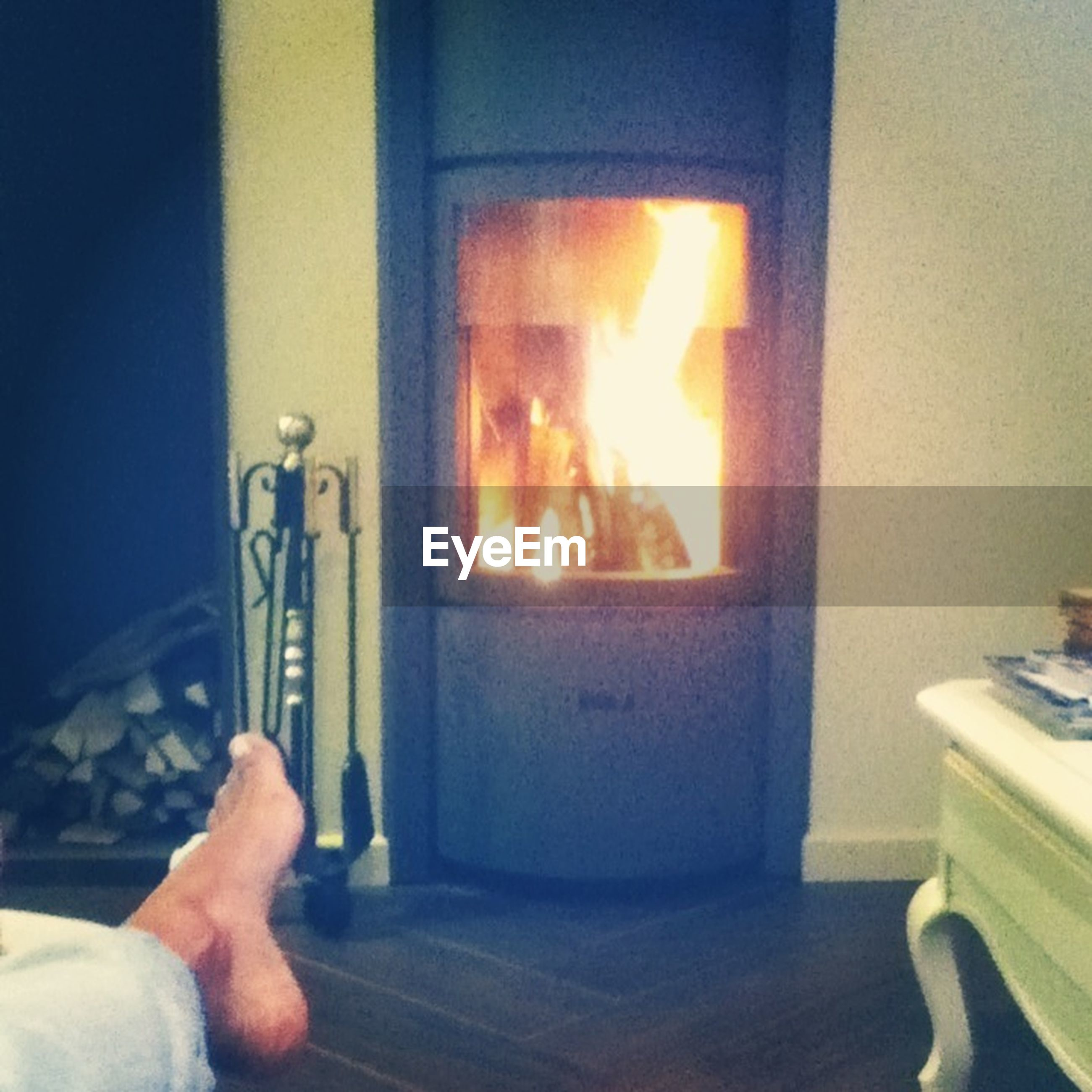 person, indoors, part of, holding, unrecognizable person, cropped, personal perspective, men, lifestyles, human finger, flame, burning, home interior, leisure activity, heat - temperature, illuminated, domestic room