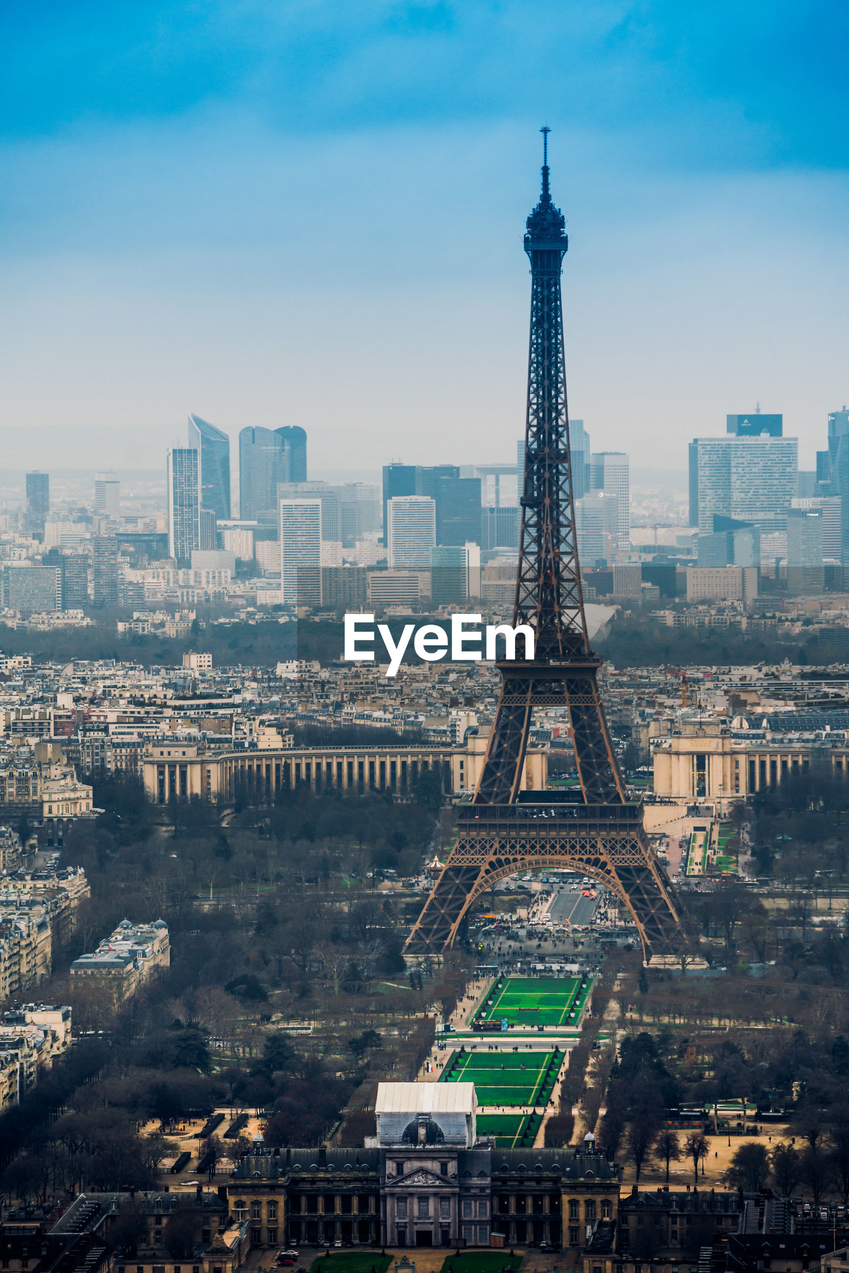 Eiffel tower amidst buildings in city