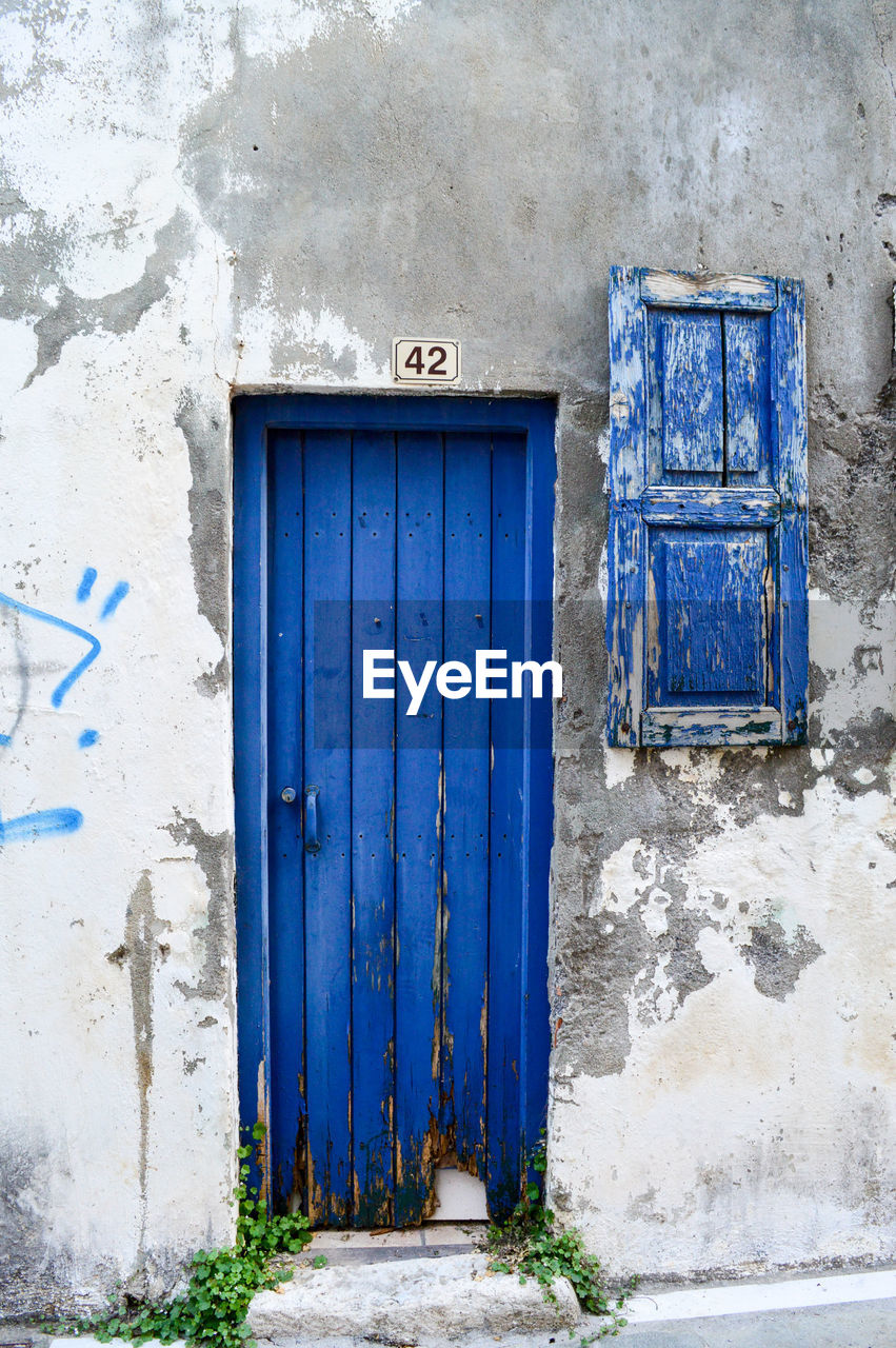 door, closed, architecture, built structure, entrance, blue, day, building exterior, no people, outdoors, doorway