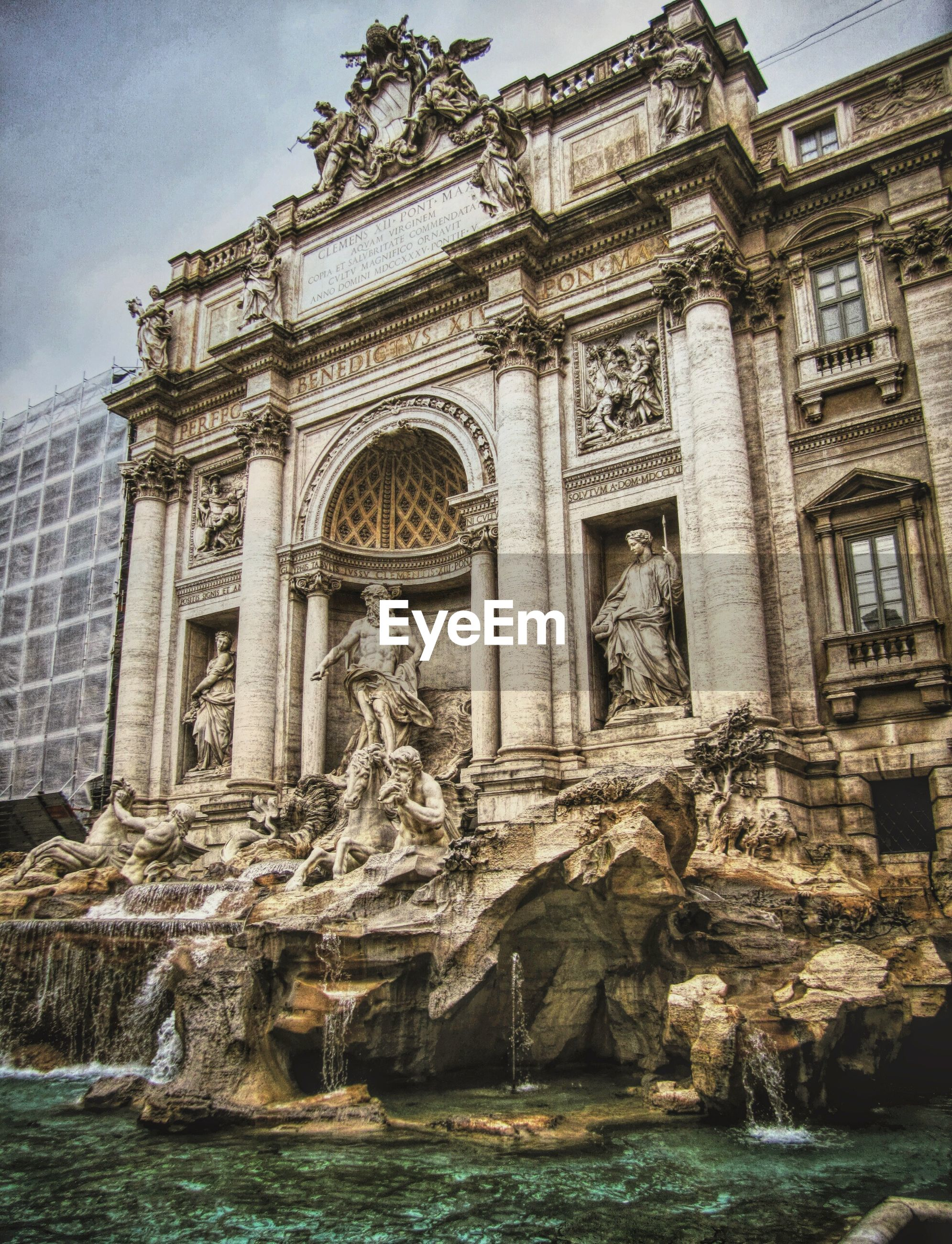 Statues at trevi fountain in city