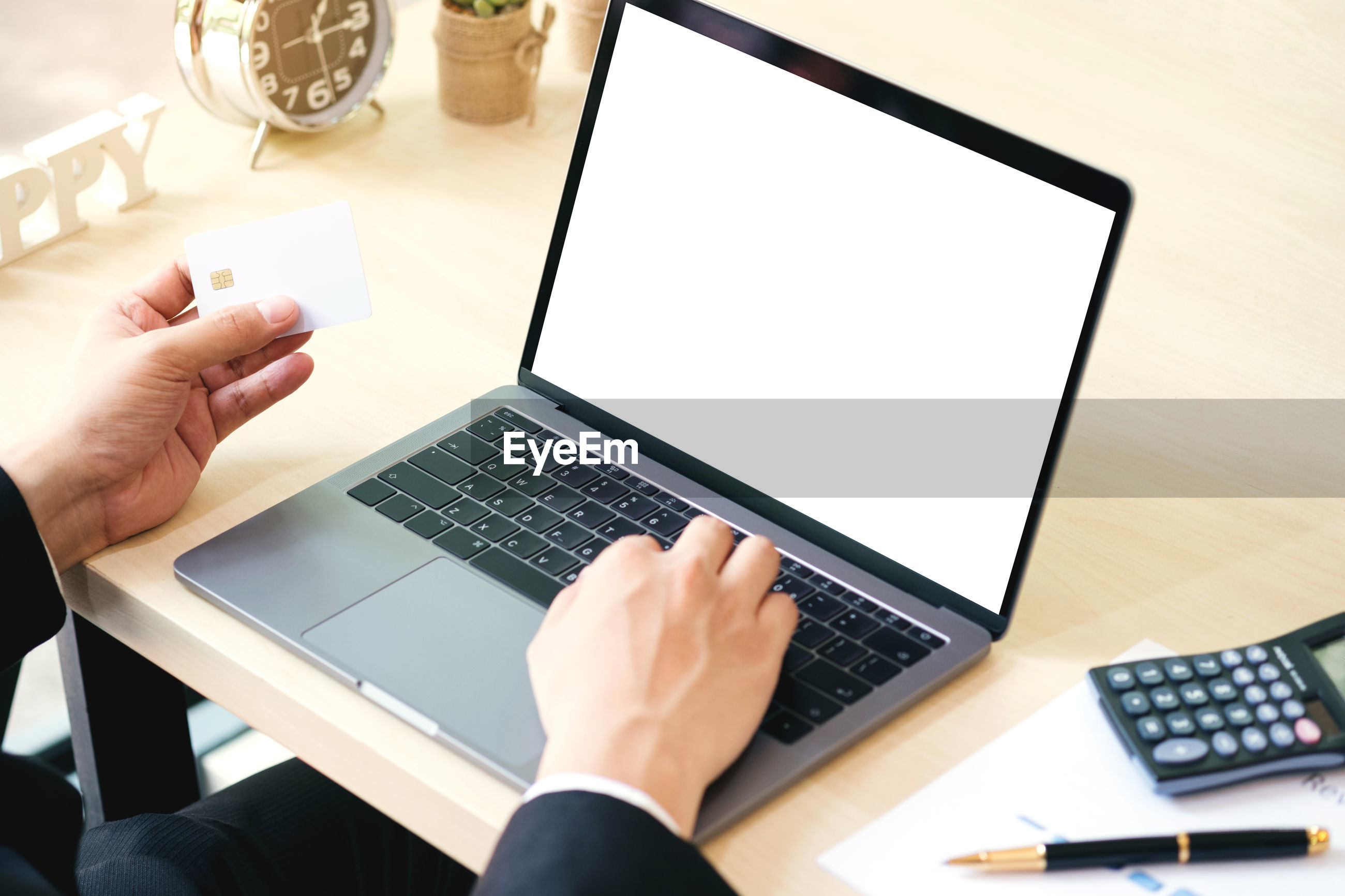 Close-up of businessman using laptop on table