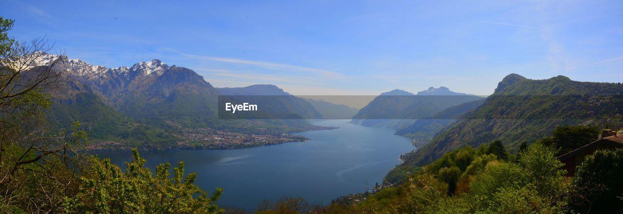Calm lake against rocky mountain
