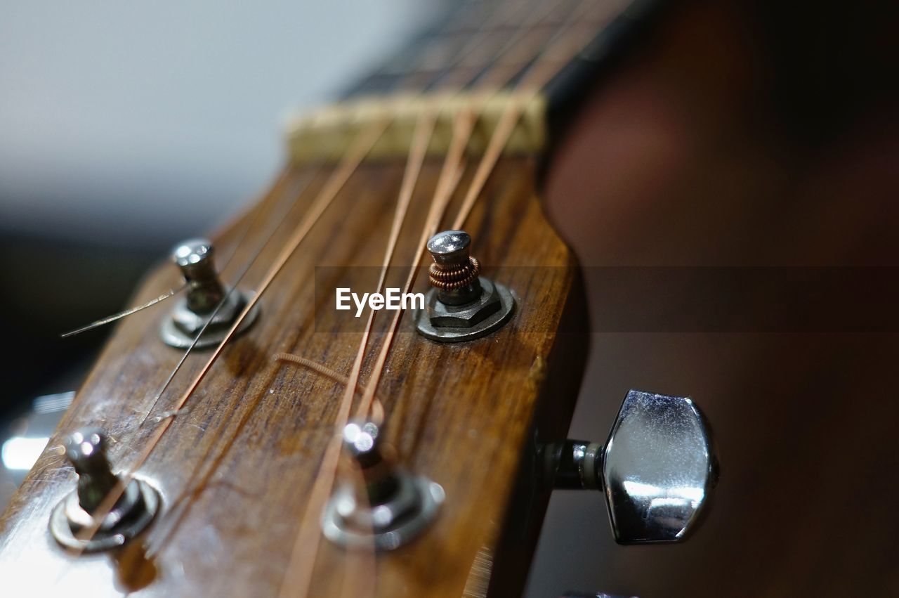 CLOSE-UP OF GUITAR ON METAL