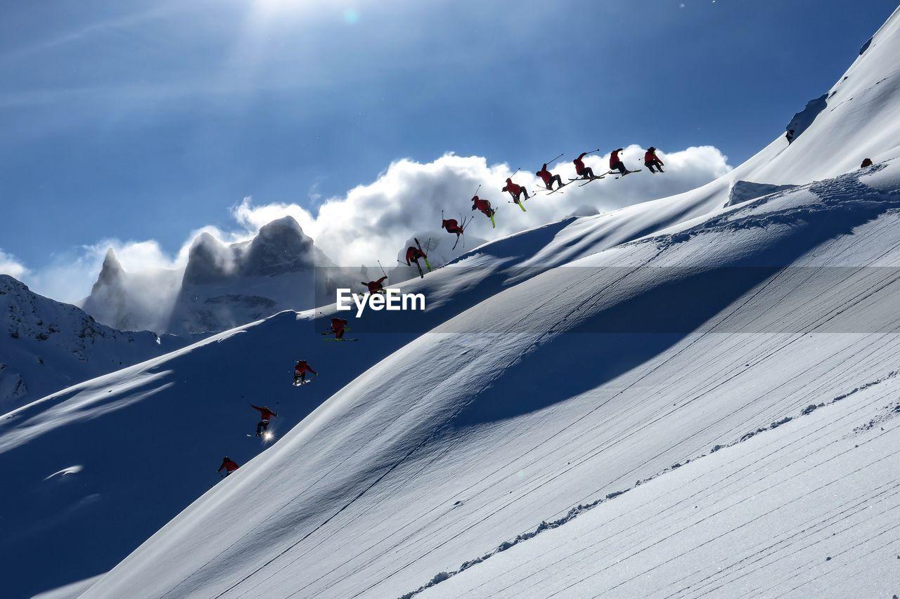sky, winter, beauty in nature, scenics - nature, cold temperature, snow, mountain, cloud - sky, nature, environment, day, adventure, tranquil scene, mountain range, non-urban scene, sport, sunlight, white color, skiing, snowcapped mountain