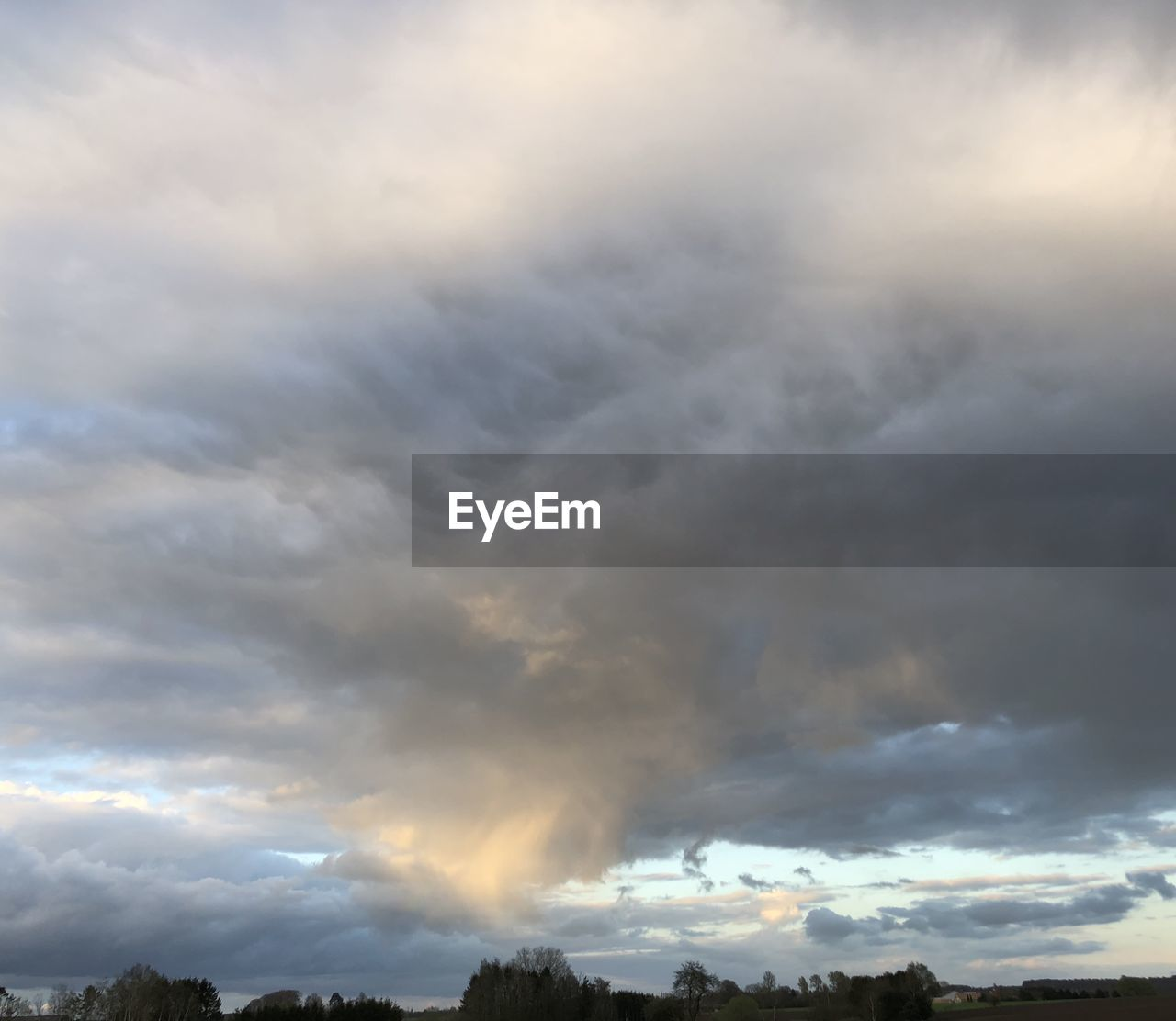 LOW ANGLE VIEW OF STORM CLOUDS OVER SKY