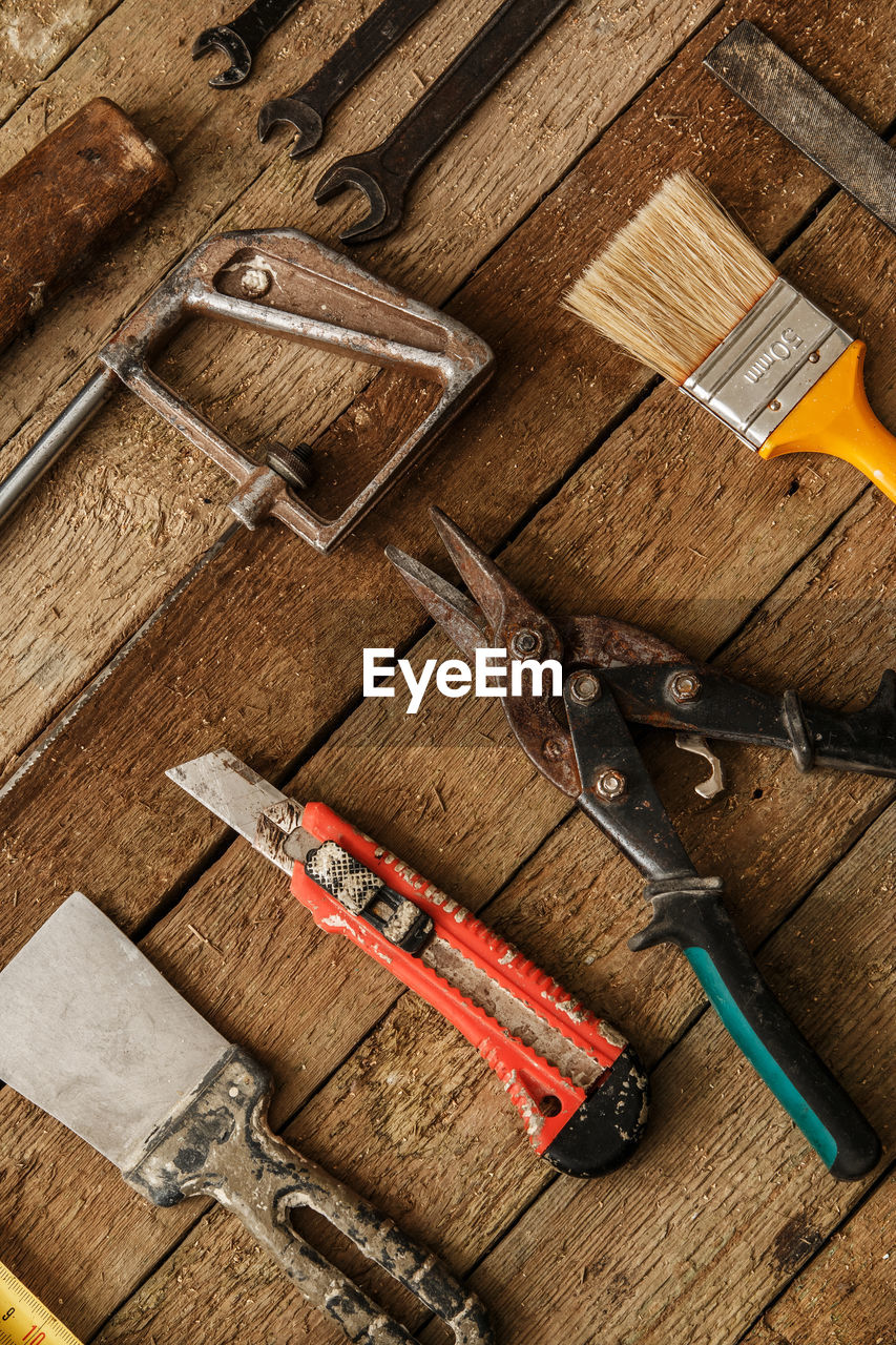 High angle view of work tools on wooden table