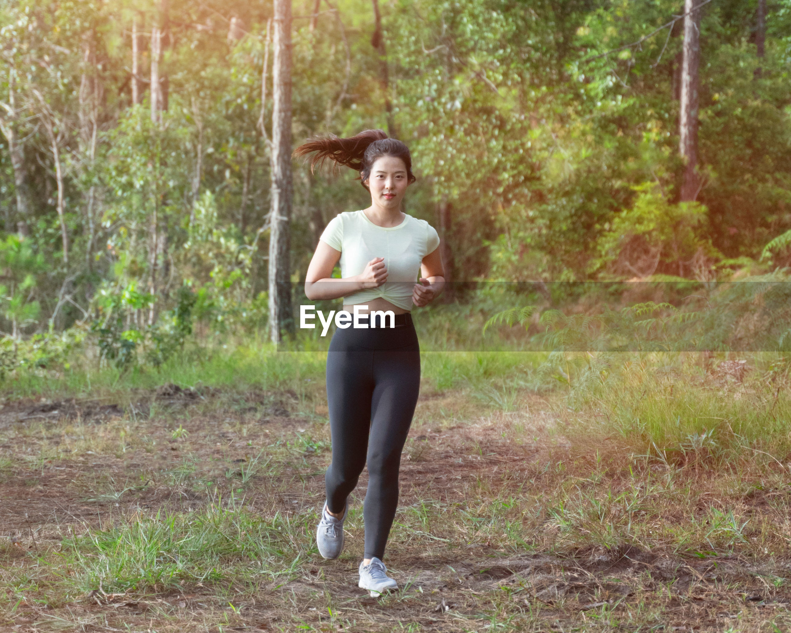 Full length of woman jogging at park