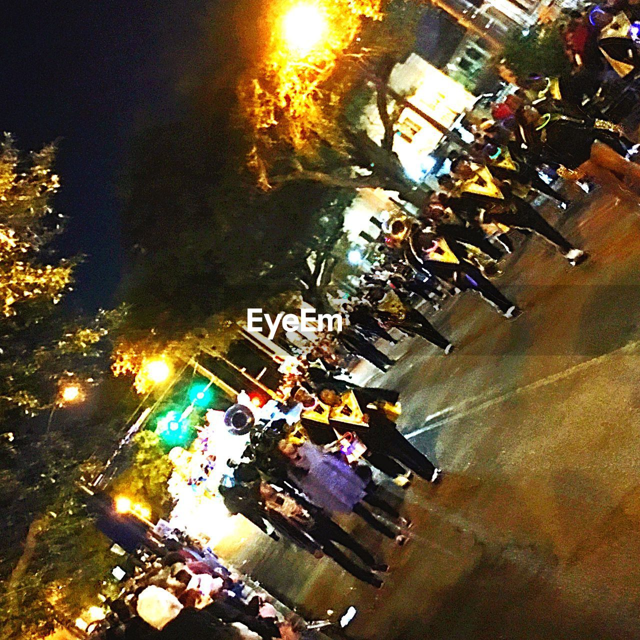 large group of people, high angle view, real people, men, crowd, outdoors, tree, illuminated, road, togetherness, city, women, building exterior, architecture, day, people