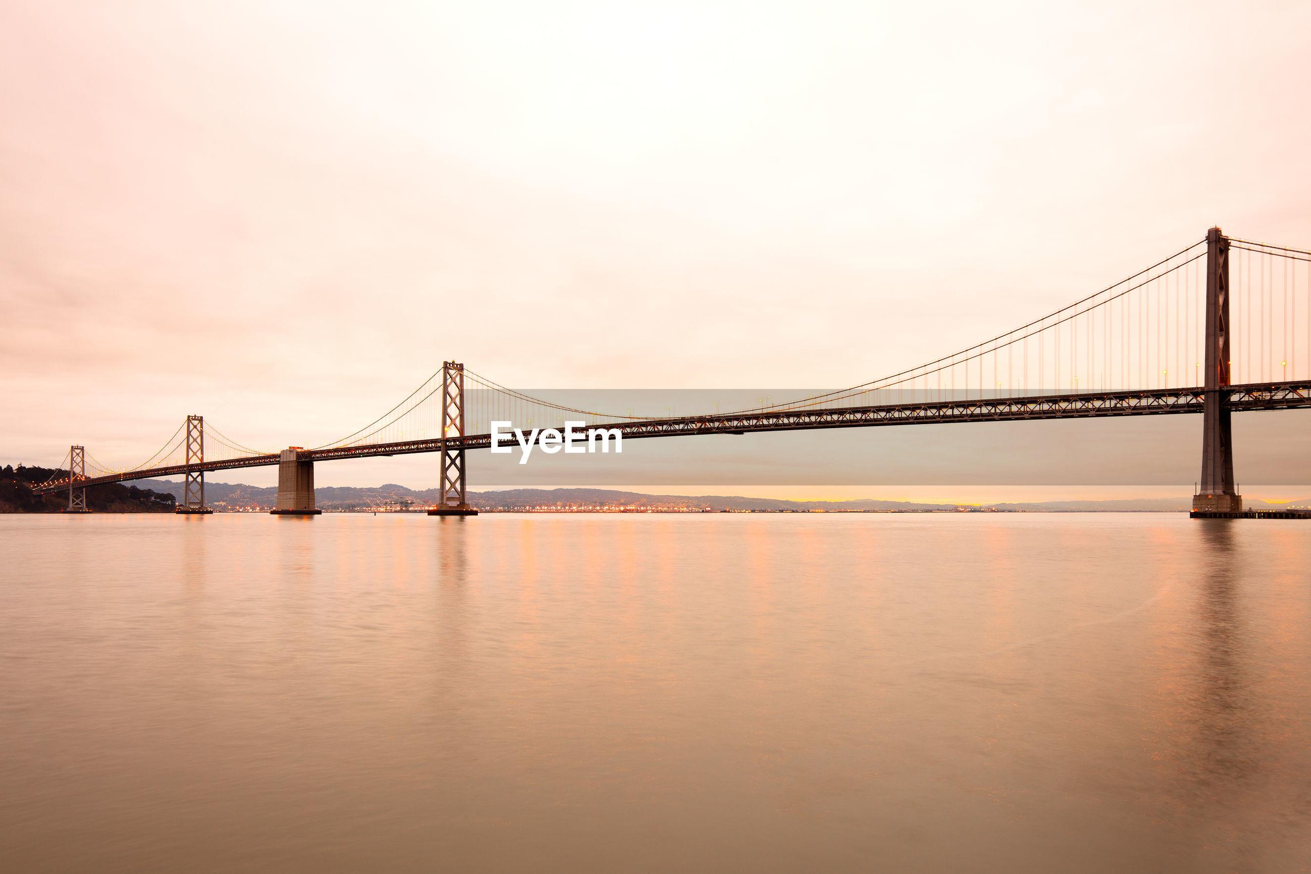 VIEW OF SUSPENSION BRIDGE OVER WATER