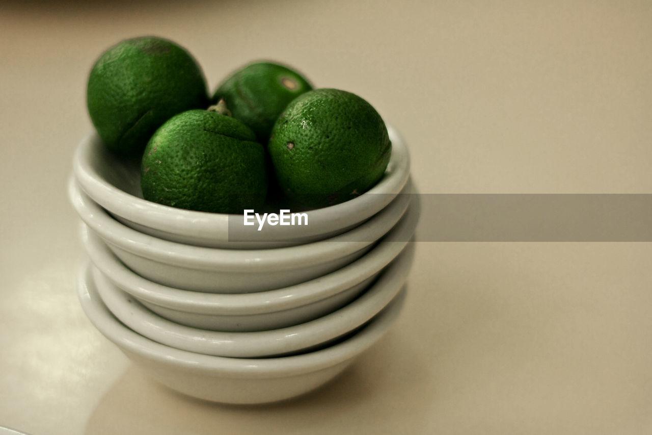 Close-up of lemons in bowls