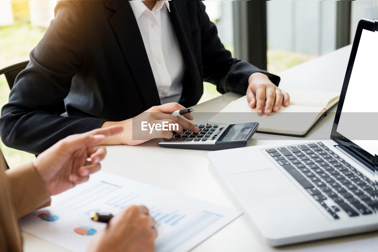 technology, computer, wireless technology, table, business, laptop, office, connection, communication, business person, businessman, midsection, adult, men, corporate business, indoors, using laptop, people, furniture, working