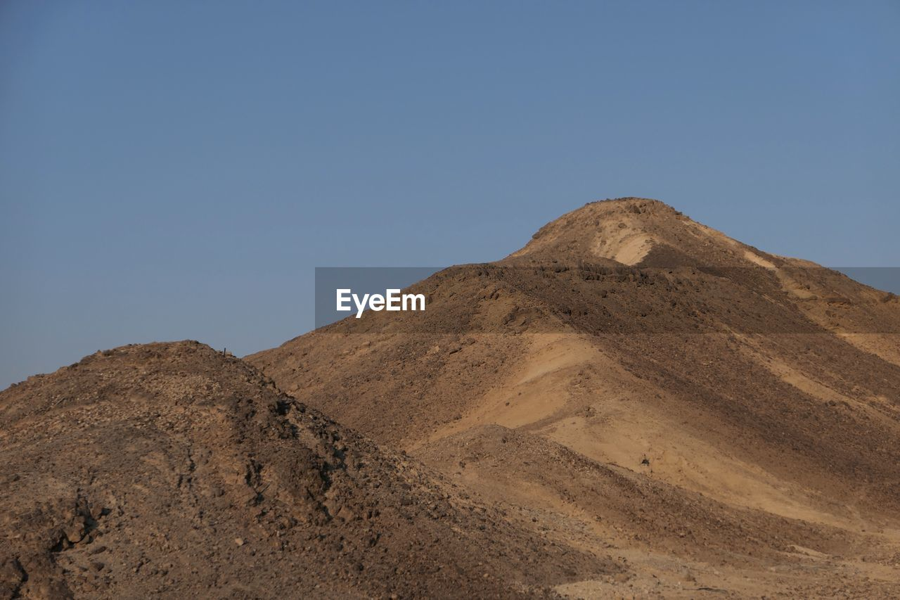 sky, clear sky, mountain, nature, copy space, tranquility, scenics - nature, environment, tranquil scene, landscape, beauty in nature, no people, land, day, physical geography, blue, desert, non-urban scene, low angle view, climate, arid climate, outdoors, mountain peak, formation