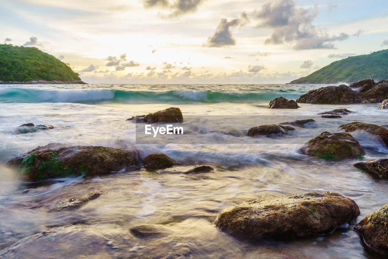 water, sea, sky, beauty in nature, scenics - nature, cloud - sky, rock, rock - object, solid, beach, land, nature, motion, tranquility, no people, tranquil scene, day, outdoors, non-urban scene, flowing water, shallow, pebble